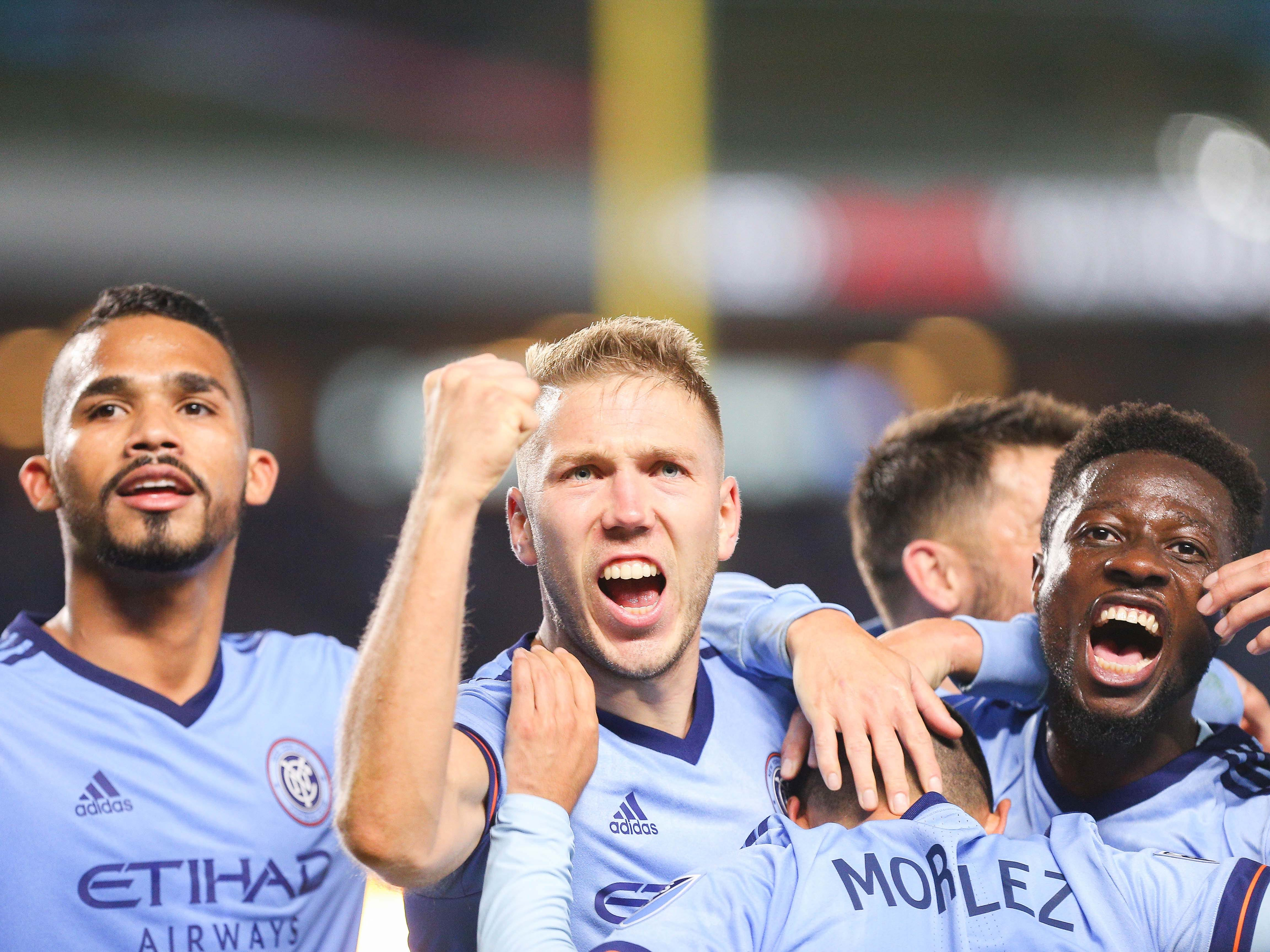 New York City FC players celebrate a goal during the second half against the Philadelphia Union at Yankee Stadium. NYCFC won the game, 3-1.
