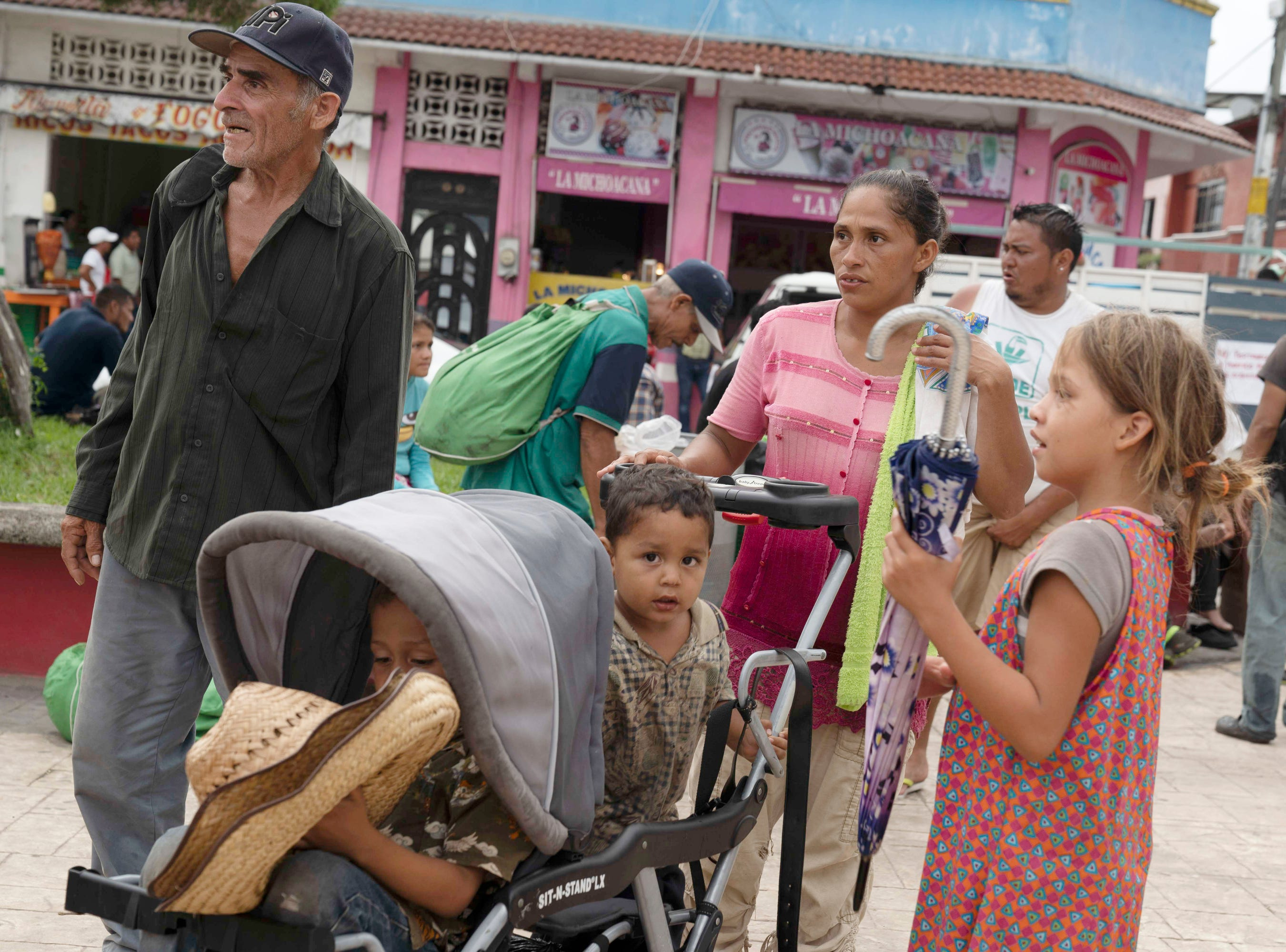 In Huixtla, Mexico, Yeni Cananero, 30, said she and her husband joined hundreds of migrants who waded across the chin deep river with their four children because the bridge was blocked. They said Mexican helicopters hovered over the water to create waves to deter the migrants from attempting to cross.  She said her children almost drowned. Cantanero said they fled Honduras because gangs had threatened to kill their family.