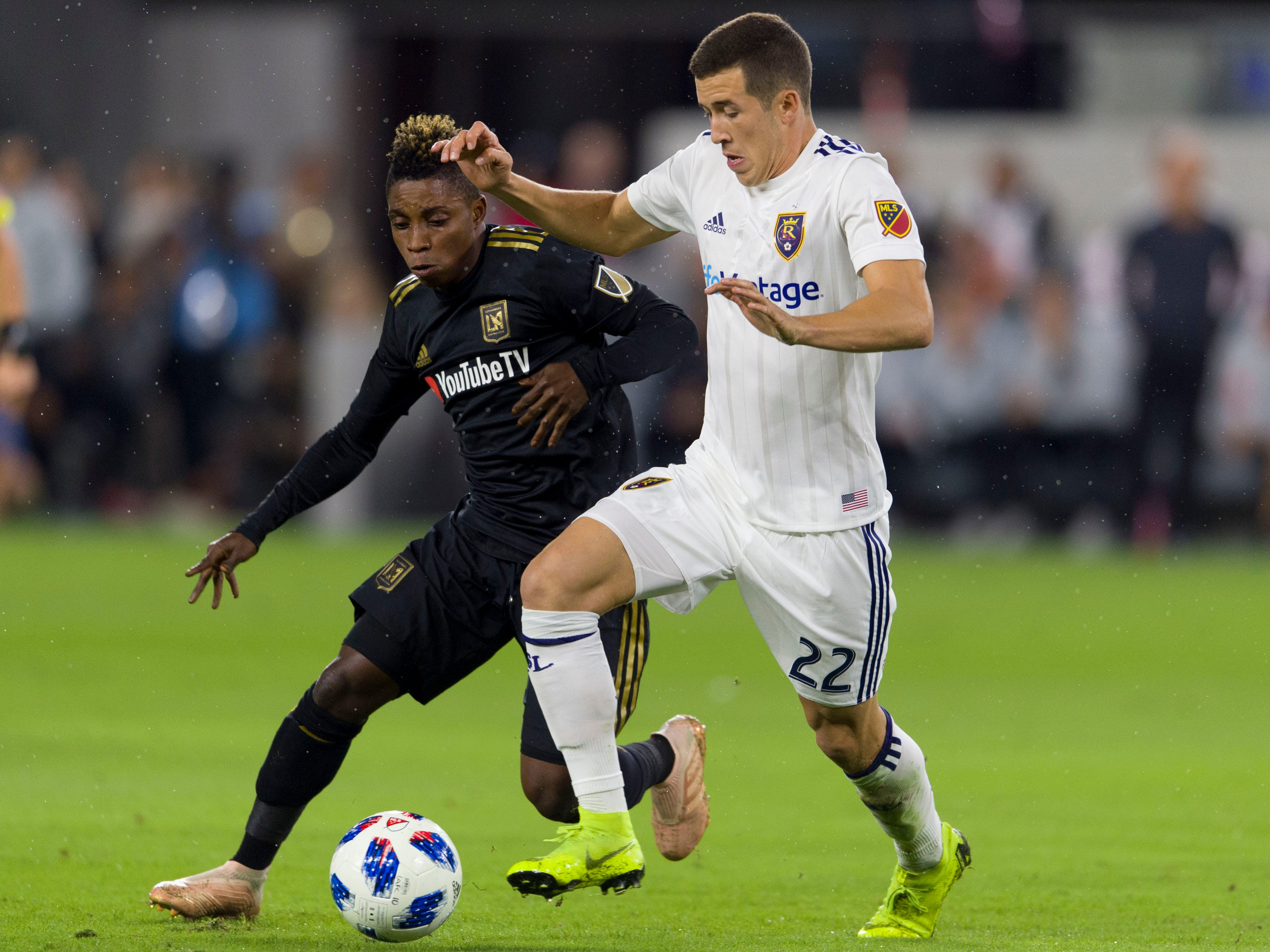Los Angeles FC midfielder Latif Blessing and Real Salt Lake defender Aaron Herrera (22) battle for the ball during the first half at Banc of California Stadium.