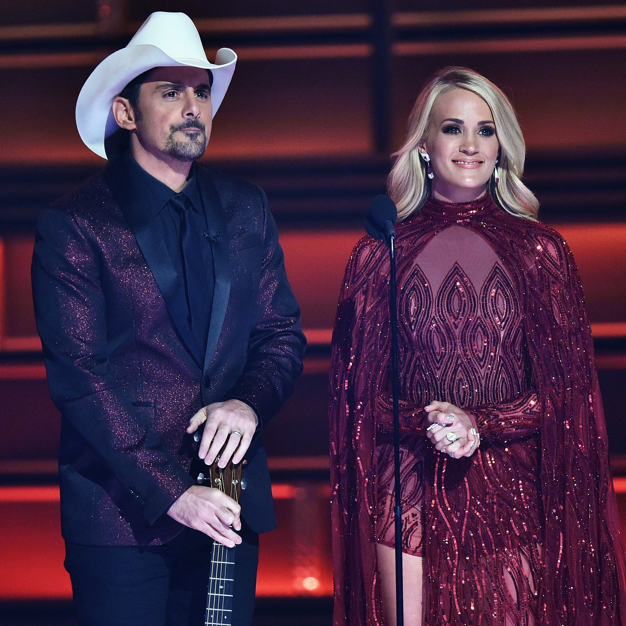 Co-hosts Brad Paisley and Carrie Underwood speak onstage at the 51st annual CMA Awards. They will be hosting the award show again this year.