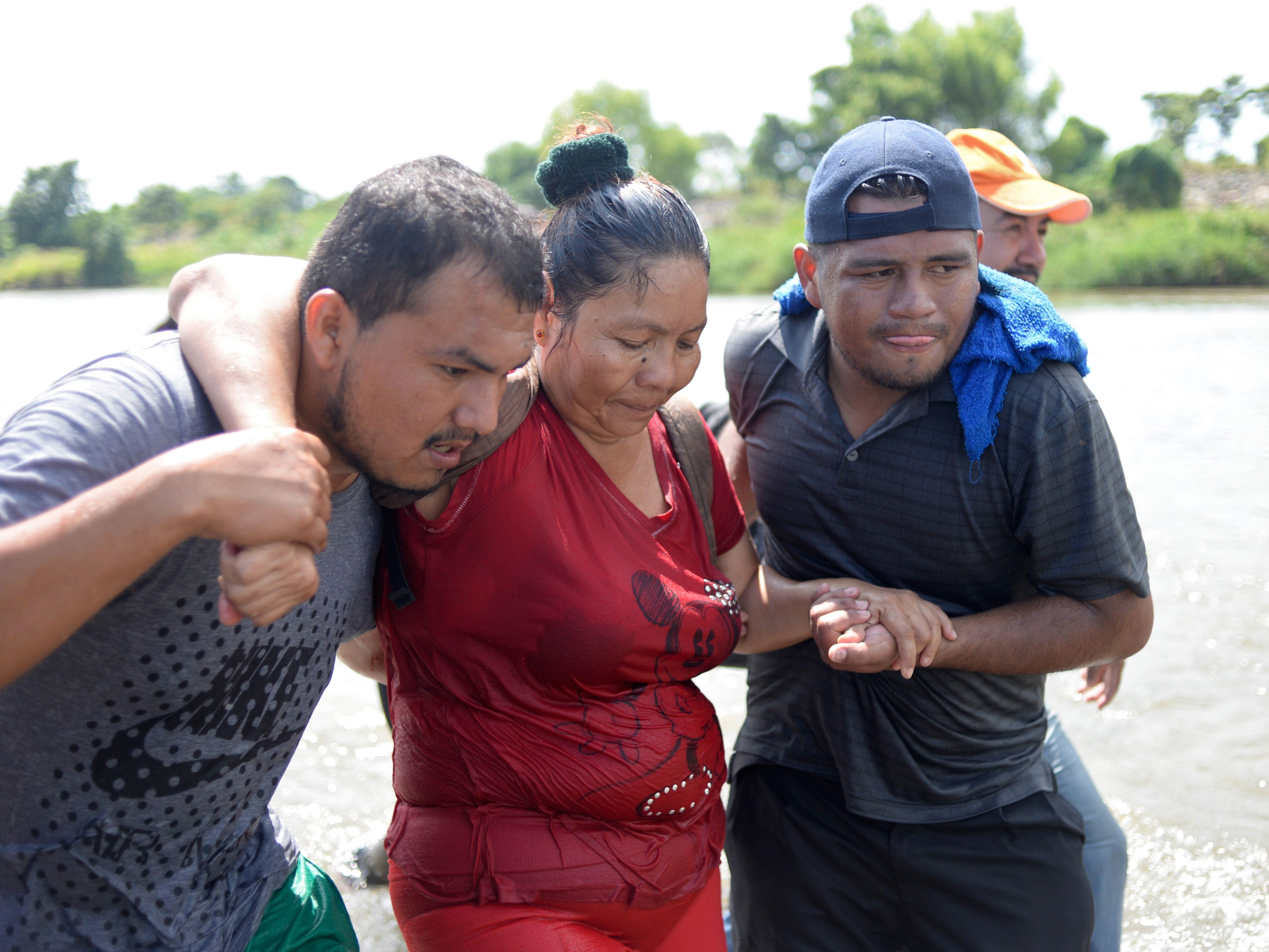 Honduran migrants heading in a caravan to the US, arrive in Ciudad Hidalgo, Mexico, after crossing the Suchiate River from Ciudad Tecun Uman, Guatemala, on Nov. 02, 2018.