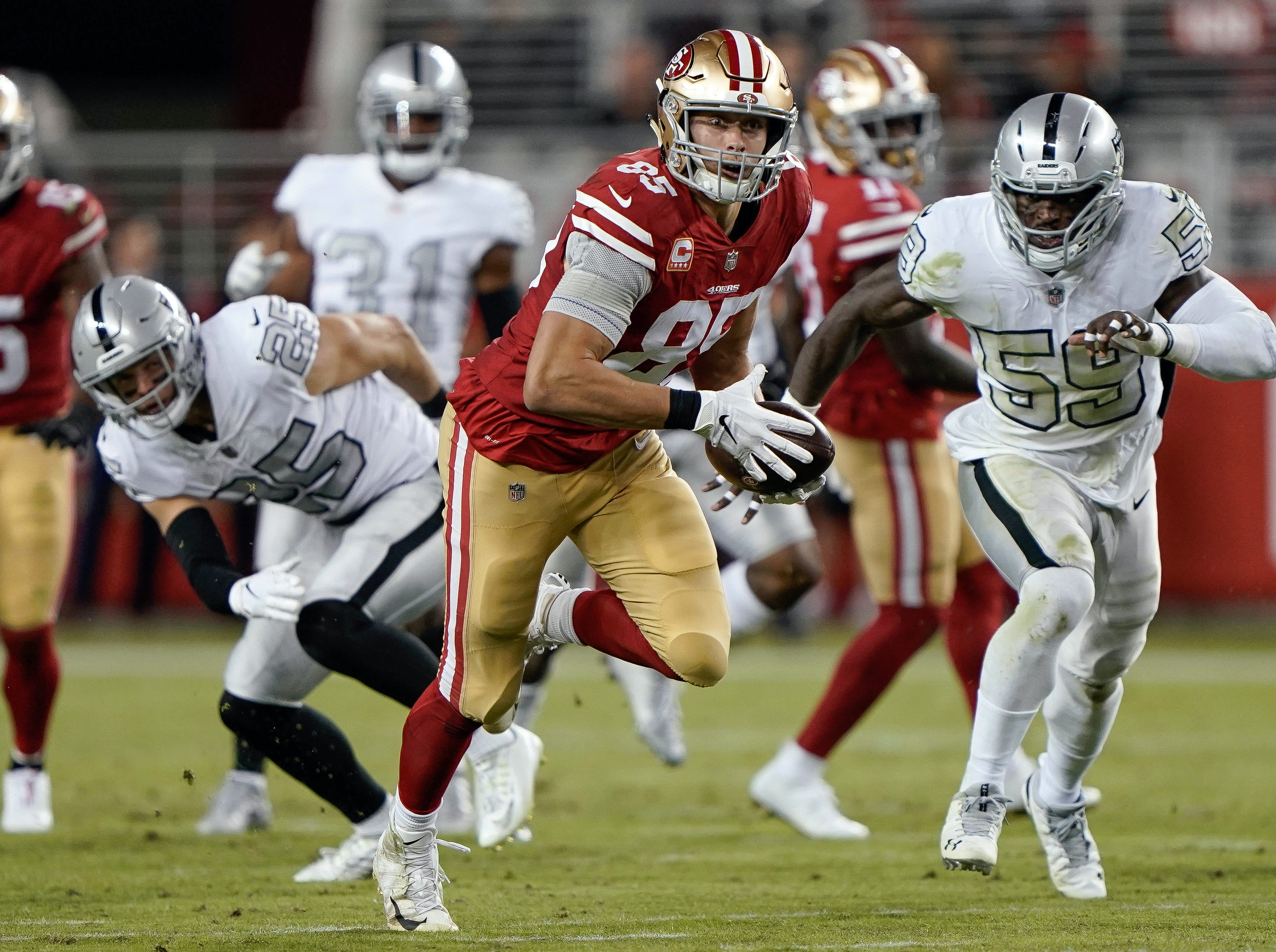 San Francisco 49ers tight end George Kittle (85) runs with the ball against the Oakland Raiders during the third quarter at Levi's Stadium.