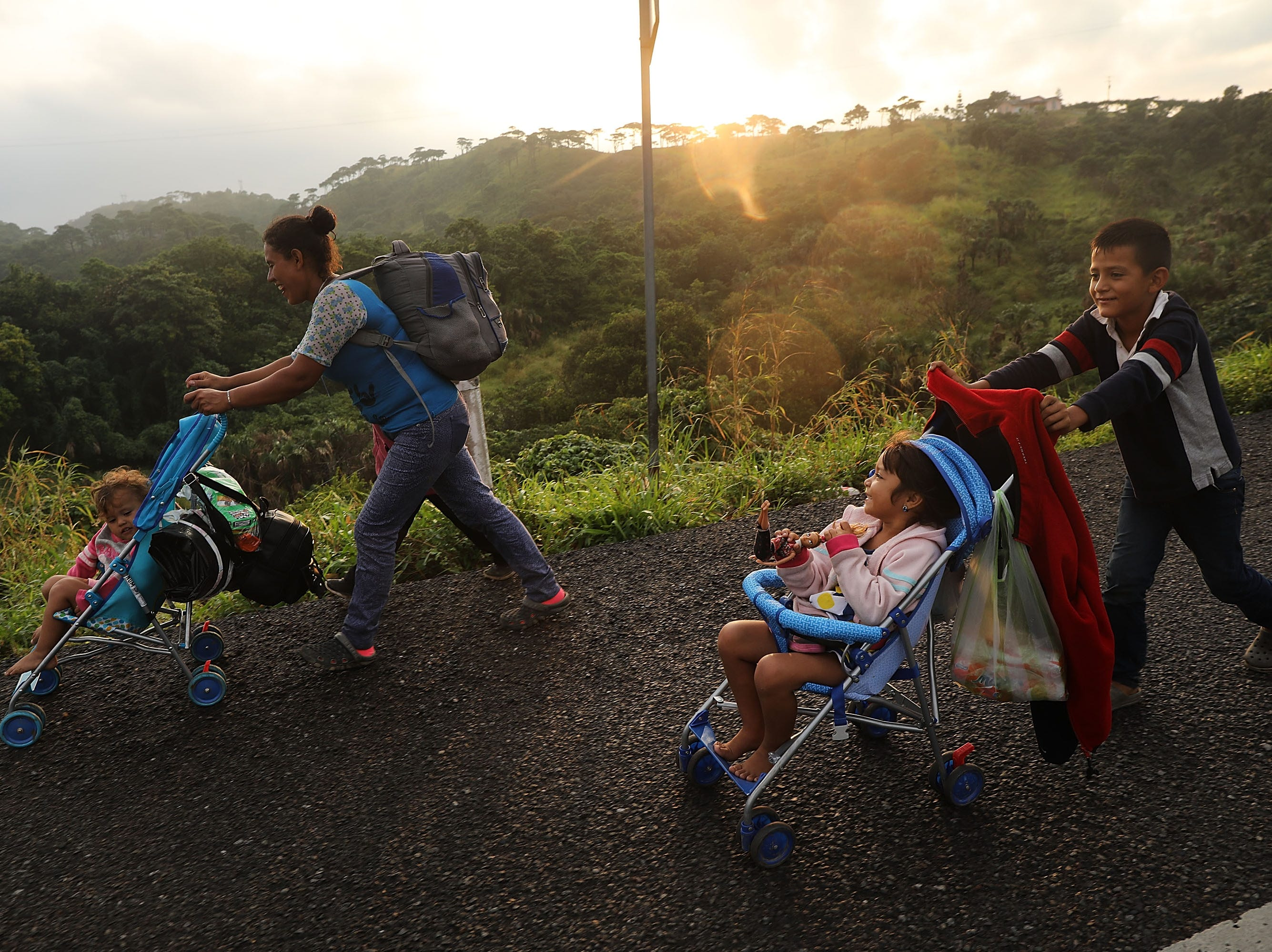 Members of the Central American migrant caravan move to the next town at dawn on Nov. 02, 2018 in Matias Romero, Mexico. The group of migrants, many of them fleeing violence in their home countries, last took a rest day on Wednesday and has resumed their journey towards the United States border. As fatigue from the heat, distance and poor sanitary conditions has set in, the numbers of people participating in the trek has slowly dwindled but a significant group are still determined to get to the United States. President Donald Trump said Wednesday as many as 15,000 active-duty troops may be deployed to the U.