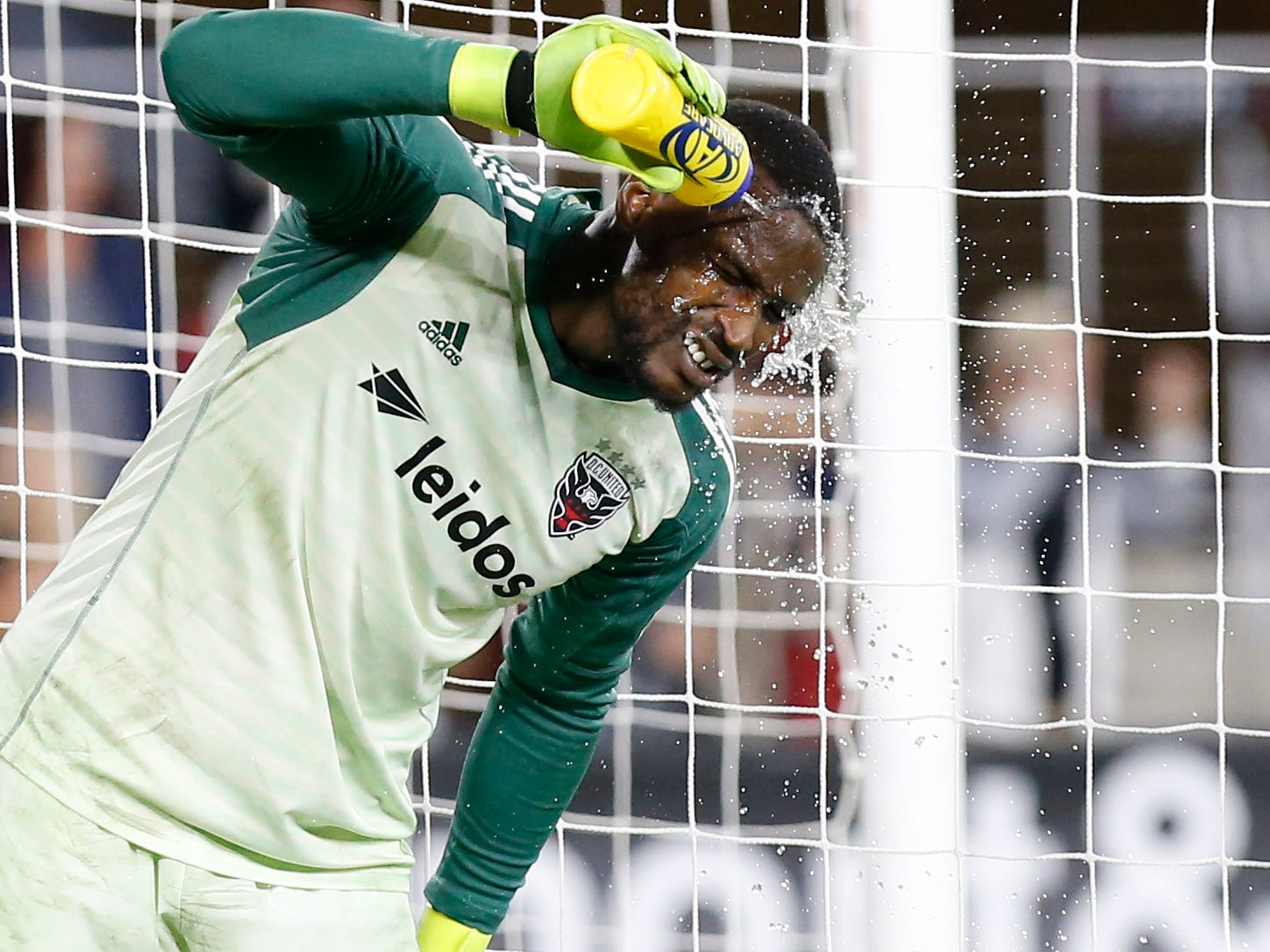 D.C. United goalkeeper Bill Hamid squirts his face with water during the knockoff playoff game against Columbus Crew SC at Audi Field.