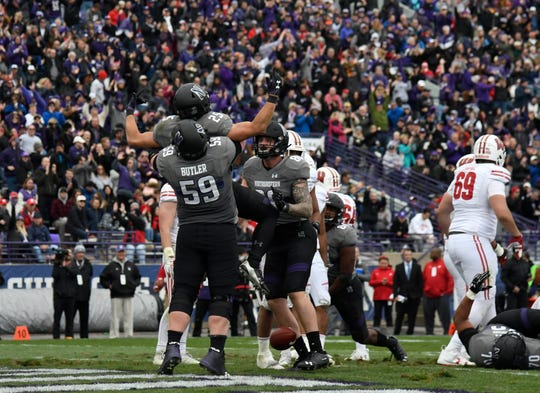Northwestern running back Isaiah Bowser celebrates with teammates after his touchdown against Wisconsin.
