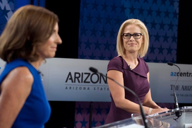 Republican Senate candidate Martha McSally (L) and Democratic Senate candidate Kyrsten Sinema (R) prepare to debate at the studios of the KAET public television station in Phoenix on Oct. 15, 2018.