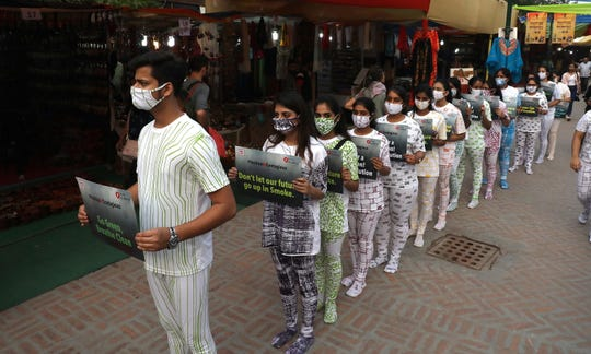 Indian students of Pearl Academy, a fashion school, wear masks and take part in a fashion march to create awareness about the air pollution in New Delhi, India on November 2, 2018.