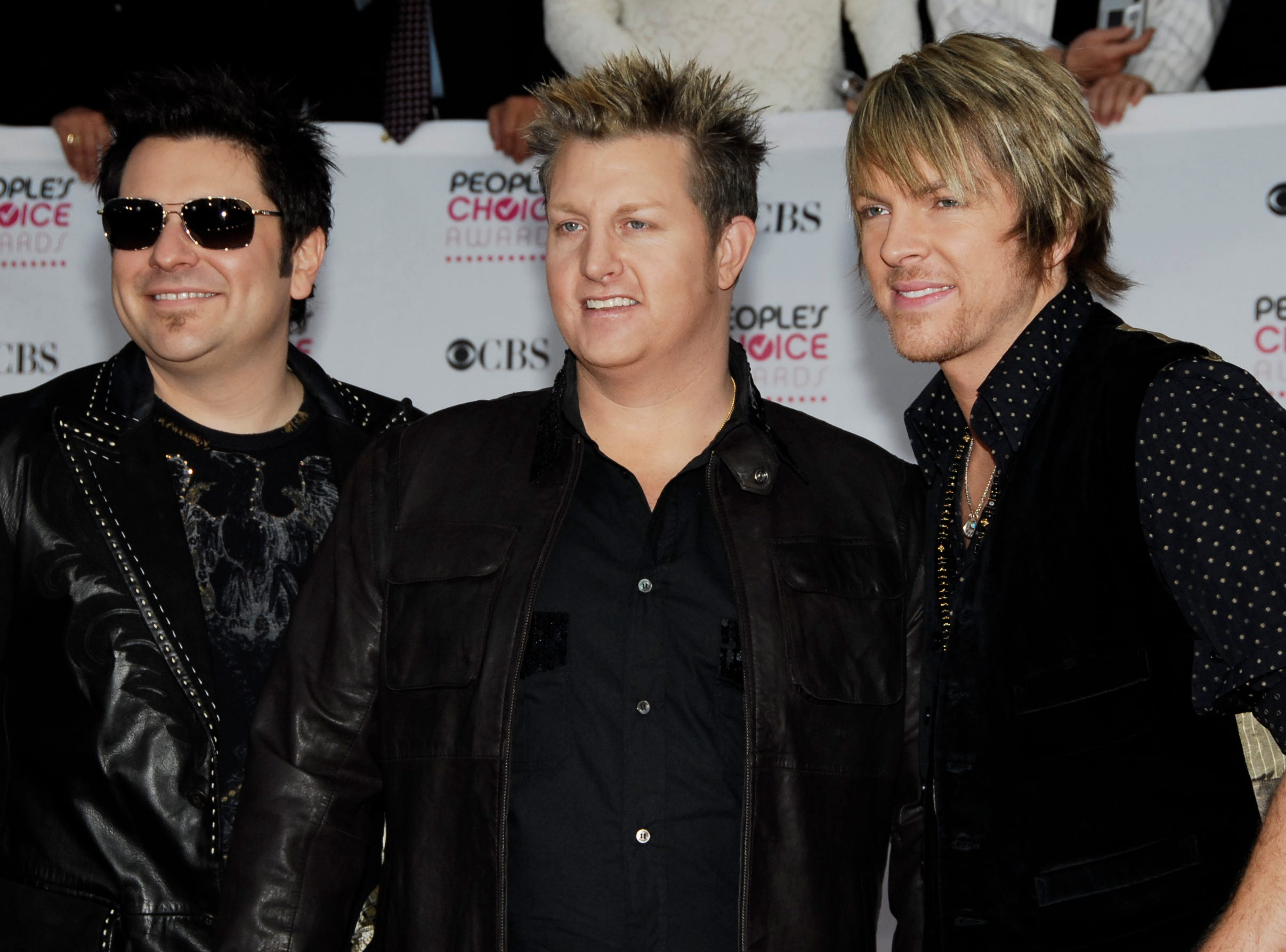 Rascal Flatts, from left: Jay DeMarcus, Gary LeVox and Joe Don Rooney arrive at the 33rd Annual People's Choice Awards on Tuesday, Jan. 9, 2007, in Los Angeles.  (AP Photo/Dan Steinberg) ORG XMIT: CAKJ101