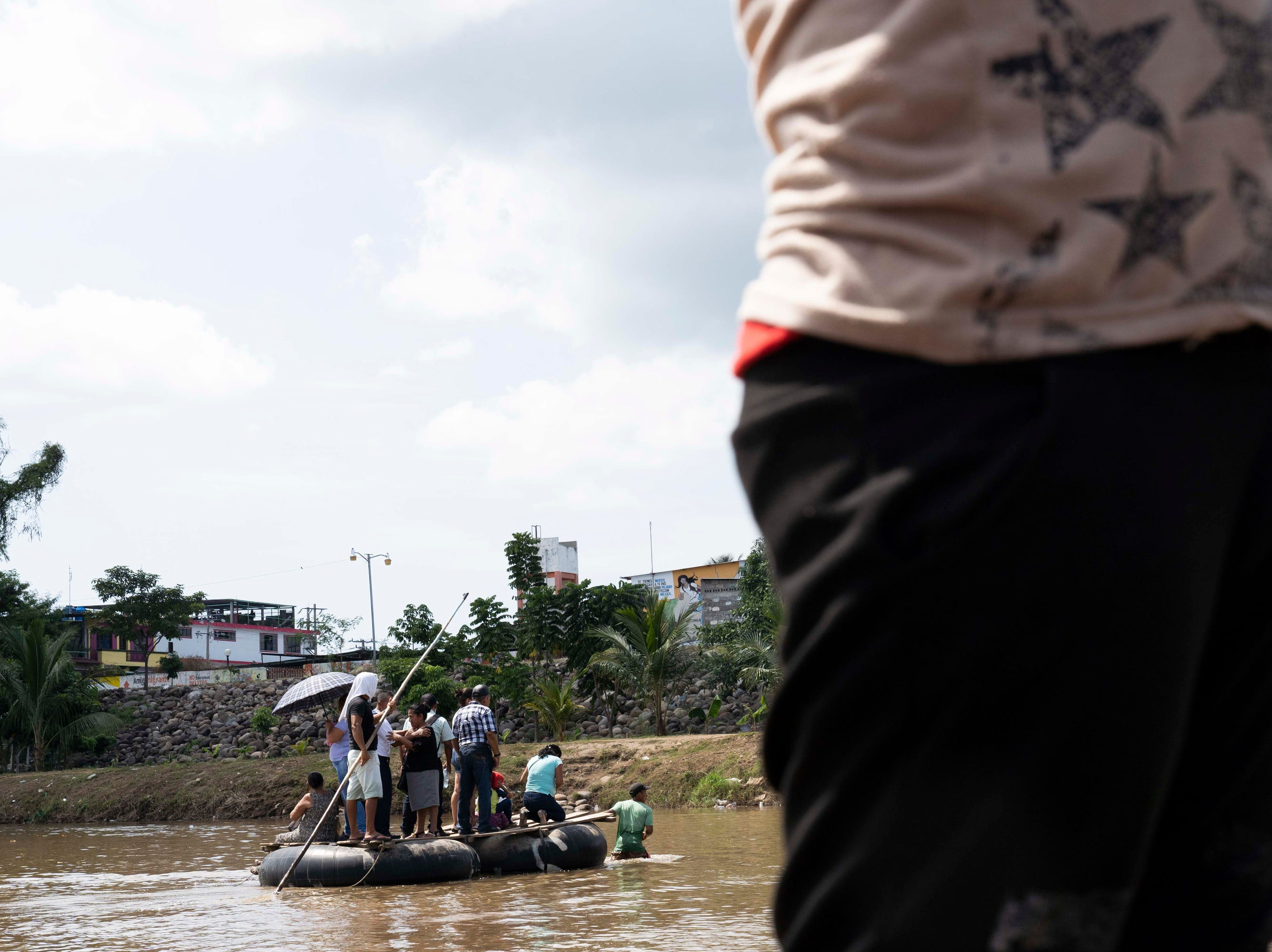 Migrants attempt to cross the Suchiate River separating Mexico from Guatemala on Nov. 1, 2018. Mexican immigration officers, federal police stood on the banks and Mexican Marines patrolled the river by boat. A Mexican immigration officer who was not authorized to speak said migrants from Central America are being offered the chance to apply for asylum to remain in Mexico as long as they can produce passports from their home countries or other documents ration.
