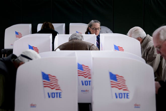 People cast their ballots at a community center.
