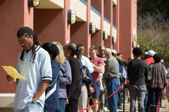 Voters wait in line for up to two hours to early vote at the Cobb County West Park Government Center on Oct. 18, 2018 in Marietta, Ga.  Early voting started in Georgia on October 15th. Georgia's Gubernatorial election is a close race between Democratic candidate Stacey Abrams and Republican candidate Brian Kemp.