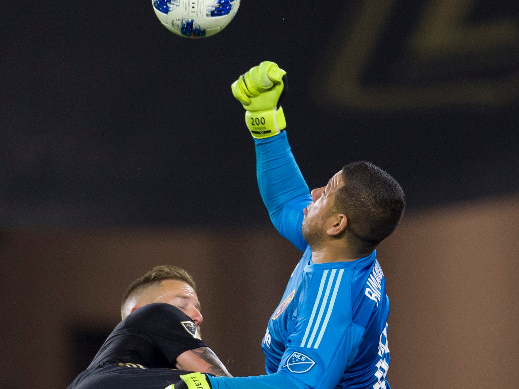 Real Salt Lake goalkeeper Nick Rimando punches the ball away during the first half against the Los Angeles FC at Banc of California Stadium.