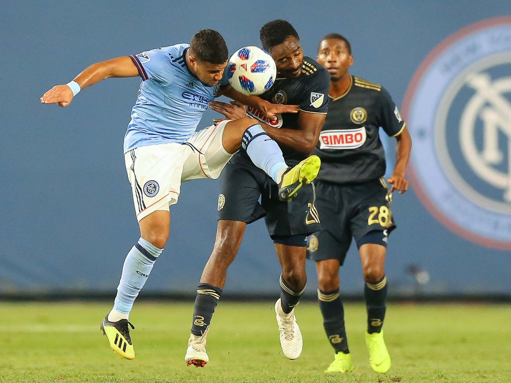New York City FC midfielder Ismael Tajouri (29) plays the ball against Philadelphia Union defender Warren Creavalle (2) in front of defender Ray Gaddis (28) during the first half at Yankee Stadium.