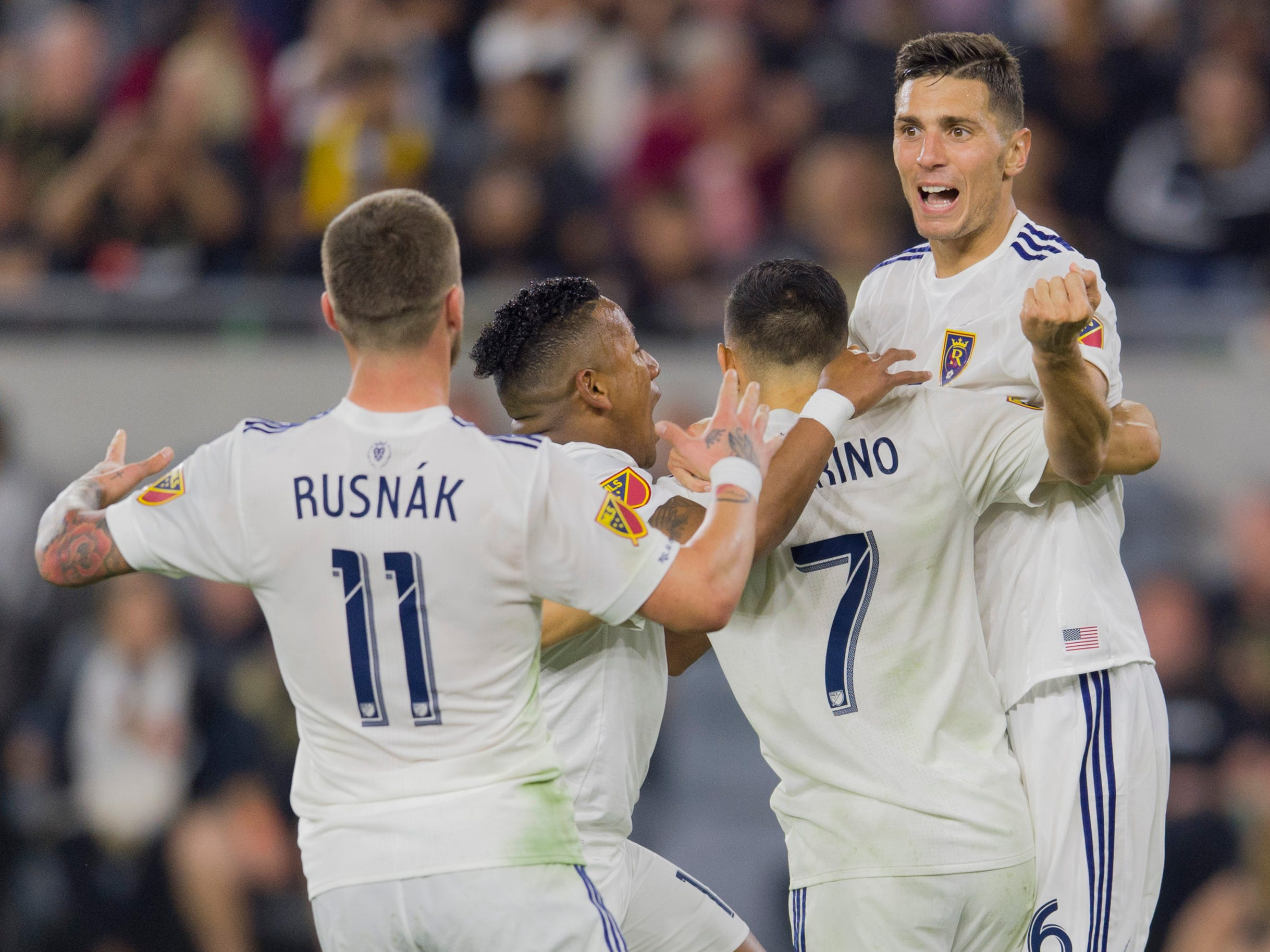 Real Salt Lake players celebrate a goal by  Jefferson Savarino (7) during the second half against the Los Angeles FC at Banc of California Stadium. Real Salt Lake won the game, 3-2.