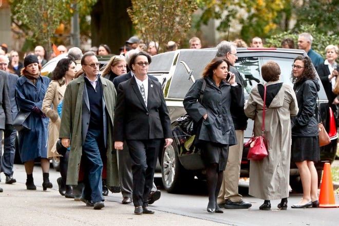 Visitors walk past the hearse as they gather for the funeral of Rose Mallinger, 97, at Congregation Rodef Shalom on Nov. 2, 2018, in Pittsburgh. Mallinger was one of the eleven victims killed in the deadly shooting at a synagogue in Pittsburgh's Squirrel Hill neighborhood last Saturday.