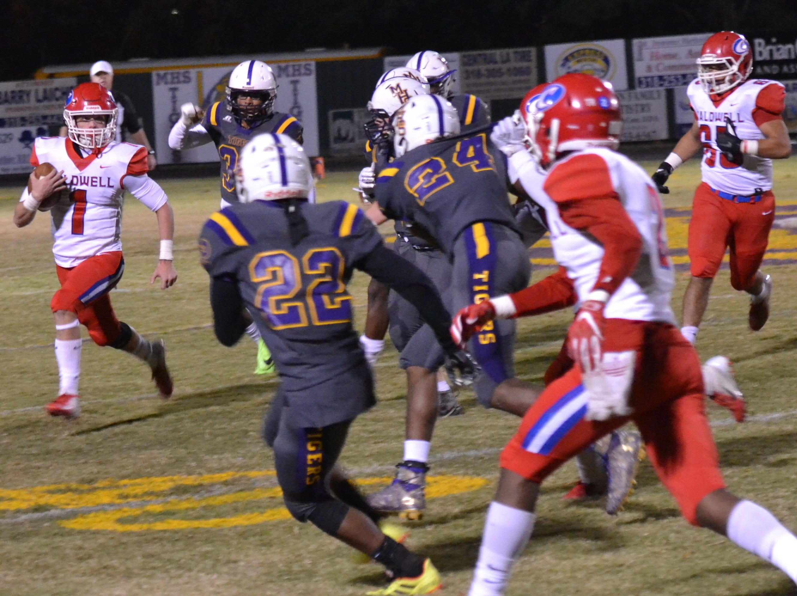Marksville defenders surround and close in on Caldwell runner Jaron Townsend (1). Marksville and Caldwell met in the regular season finale Friday night with Caldwell edging Marksville 13-8.