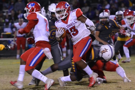 Caldwell's B.J. Cheffin (13) finds room to run in second-half action. Marksville and Caldwell met in the regular season finale Friday night with Caldwell edging Marksville 13-8.