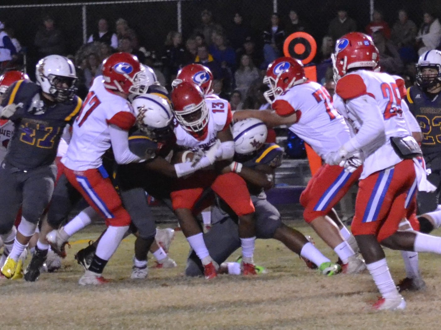 Marksville defenders converge on Caldwell's B.J. Cheffin (13). Marksville and Caldwell met in the regular season finale Friday night with Caldwell edging Marksville 13-8.