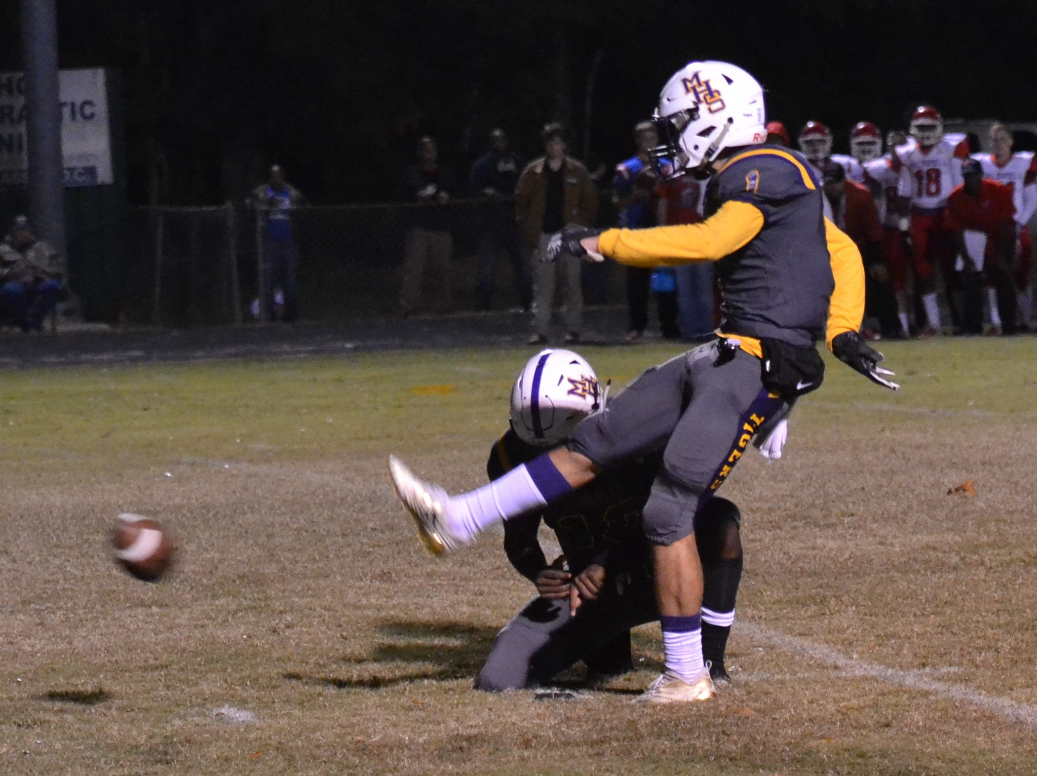 Marksville's Braydon Flores attempts a field goal. Marksville and Caldwell met in the regular season finale Friday night with Caldwell edging Marksville 13-8.