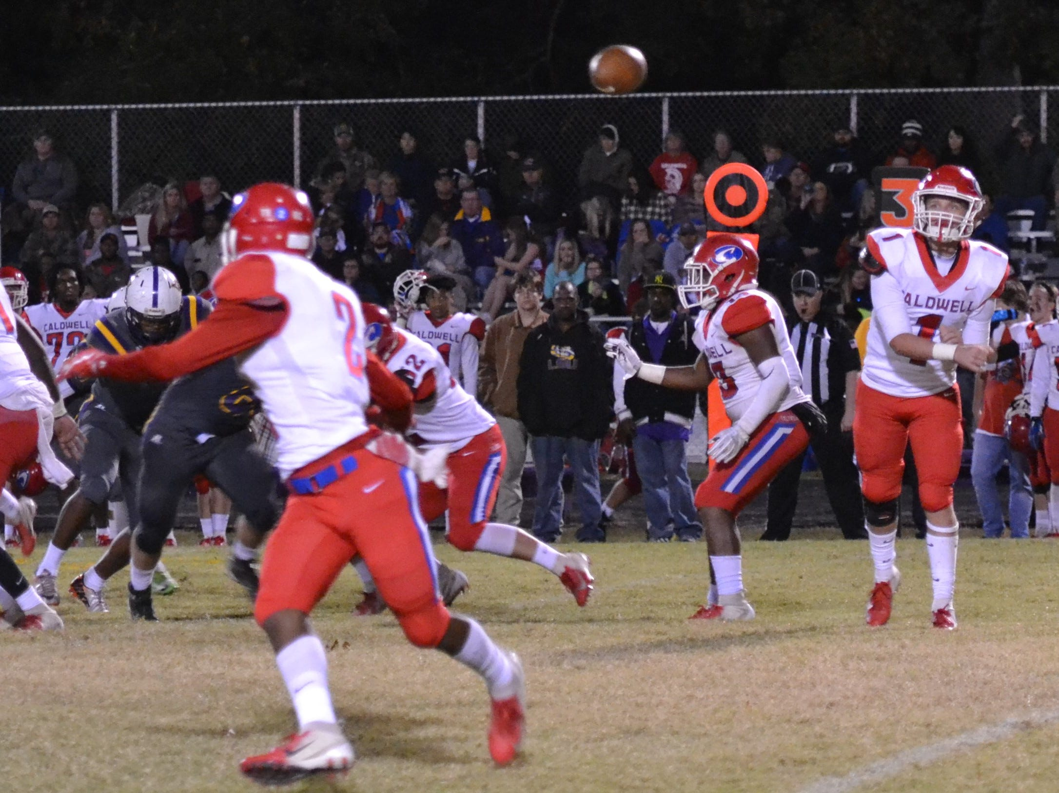 Spartan quarterback Jaron Townsend (1) makes a quick screen pass to Tavius Bryant (2). Marksville and Caldwell met in the regular season finale Friday night with Caldwell edging Marksville 13-8.