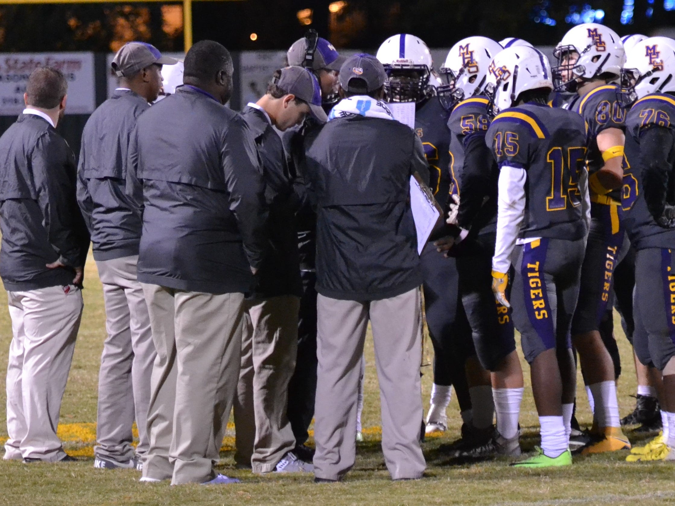 Marksville coach J.T. Dunbar meets with his team during a time out. Marksville and Caldwell met in the regular season finale Friday night with Caldwell edging Marksville 13-8.