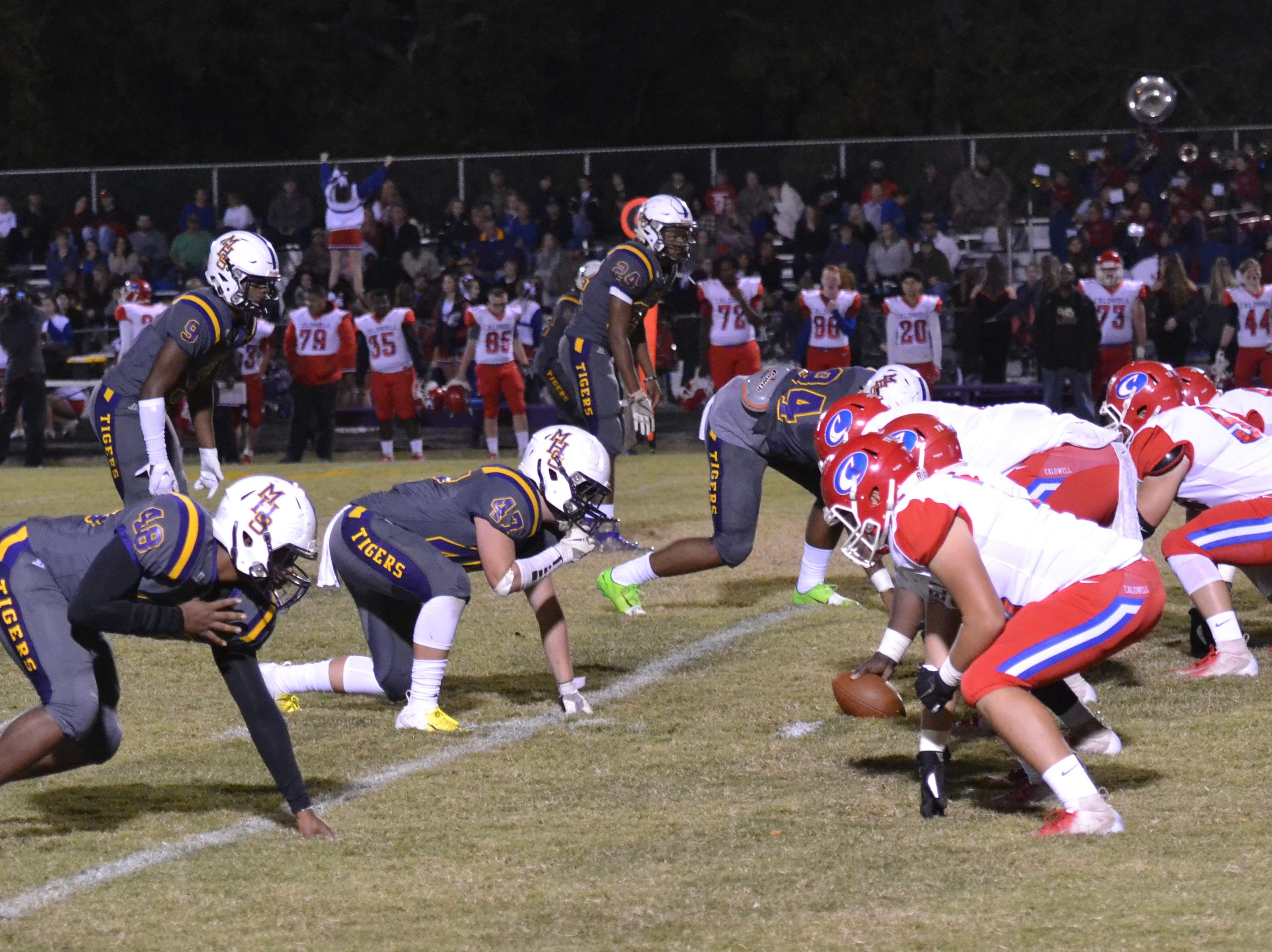 The Tigers' defense digs in against the Spartans. Marksville and Caldwell met in the regular season finale Friday night with Caldwell edging Marksville 13-8.
