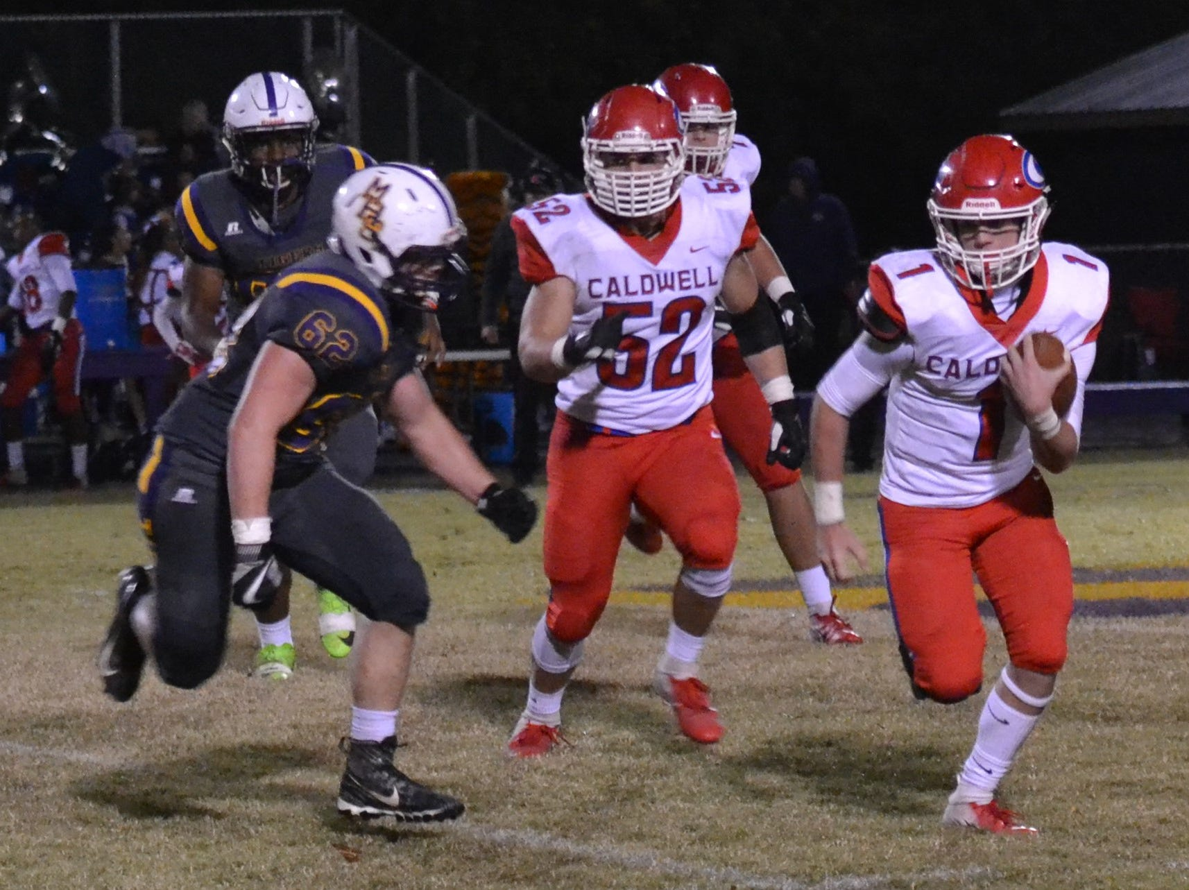 Caldwell quarterback Jaron Townsend (1) calls his own number as he tries to elude Tigers defender Gavin Laird (62). Marksville and Caldwell met in the regular season finale Friday night with Caldwell edging Marksville 13-8.