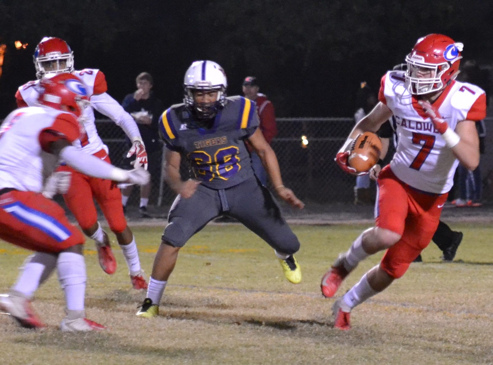 Caldwell's Cole Johnston (7) looks for room to run. Marksville and Caldwell met in the regular season finale Friday night with Caldwell edging Marksville 13-8.