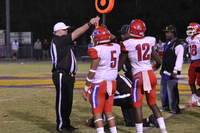 The referee indicates the Tigers made the first down by the nose of the ball during a game between Marksville and Caldwell in 2018.
