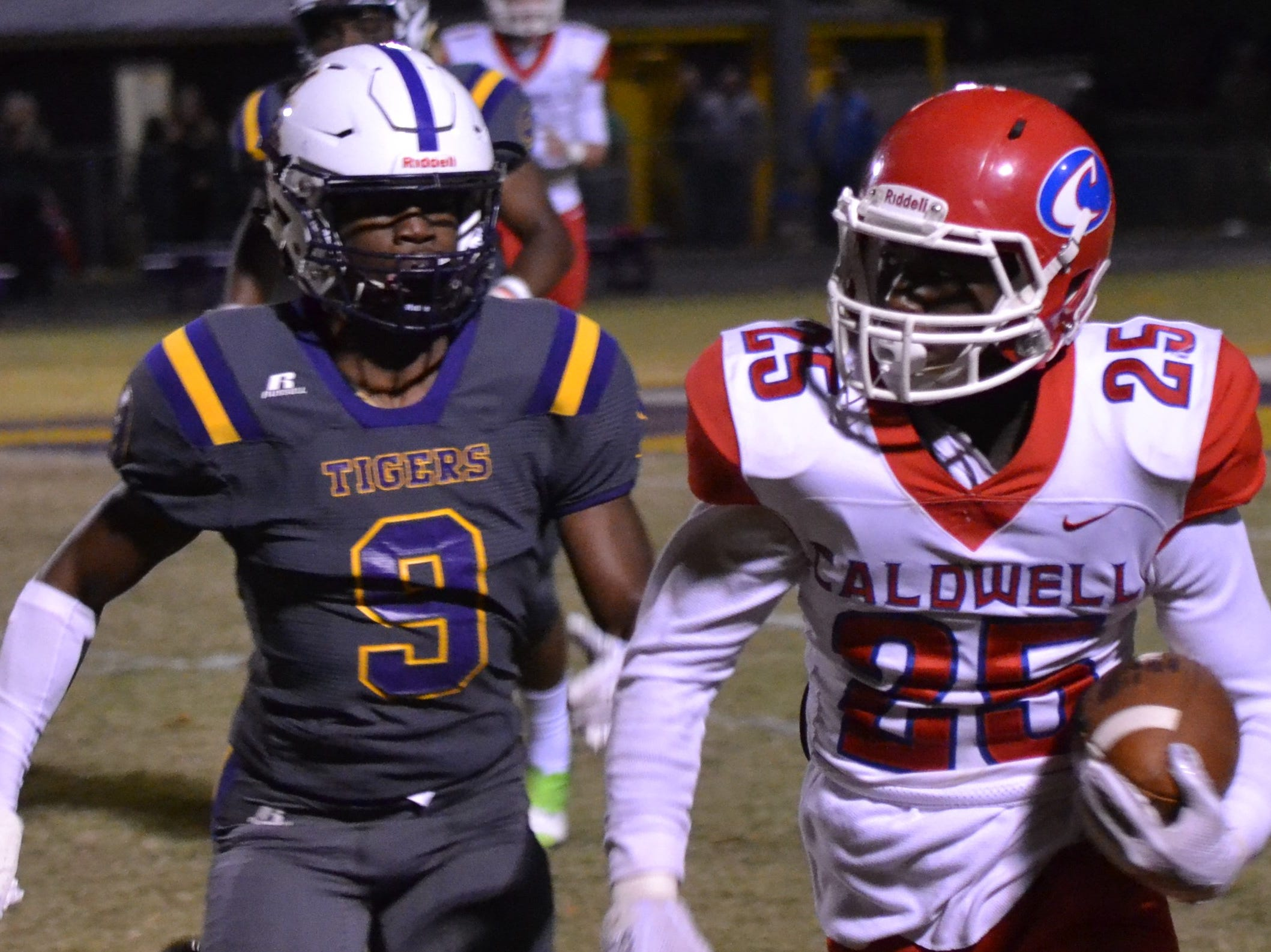 Tiger defender Clifford Champ (9) closes in on Caldwell receiver K.D. Robinson (25). Marksville and Caldwell met in the regular season finale Friday night with Caldwell edging Marksville 13-8.