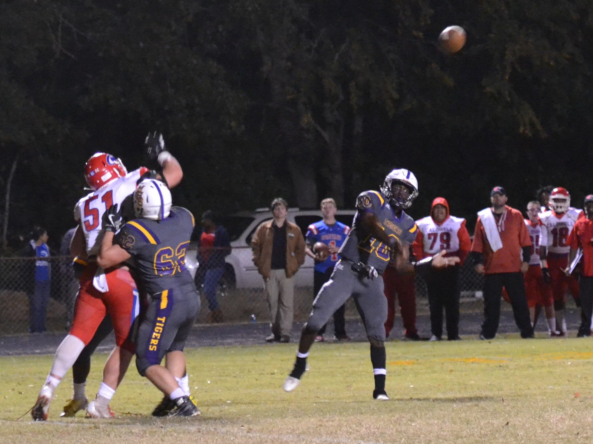 Marksville quarterback Daniel Miller lofts a pass. Marksville and Caldwell met in the regular season finale Friday night with Caldwell edging Marksville 13-8.