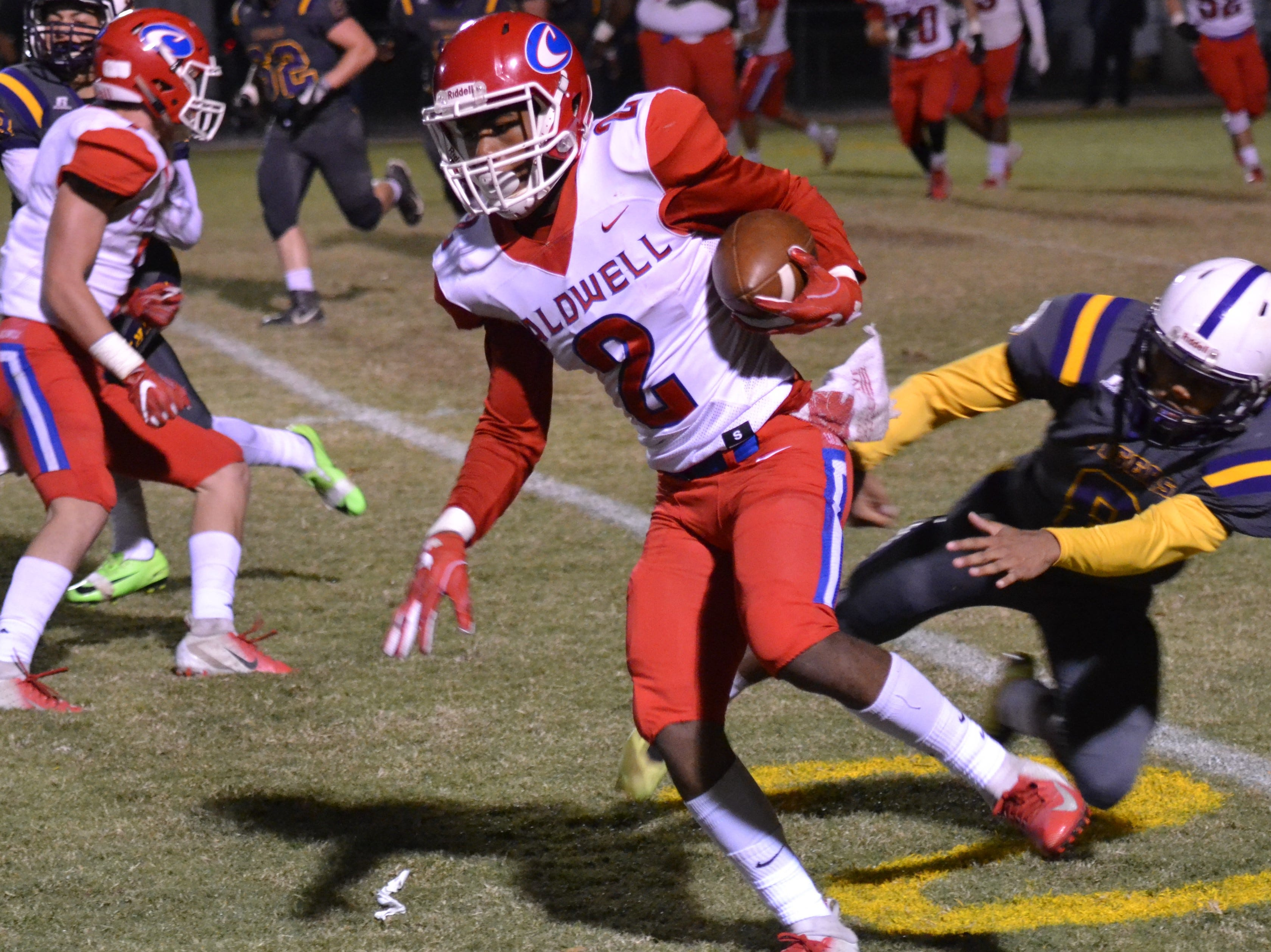 Caldwell's Tavius Bryant (2) turns the corner for a solid gain for the Spartans. Marksville and Caldwell met in the regular season finale Friday night with Caldwell edging Marksville 13-8.