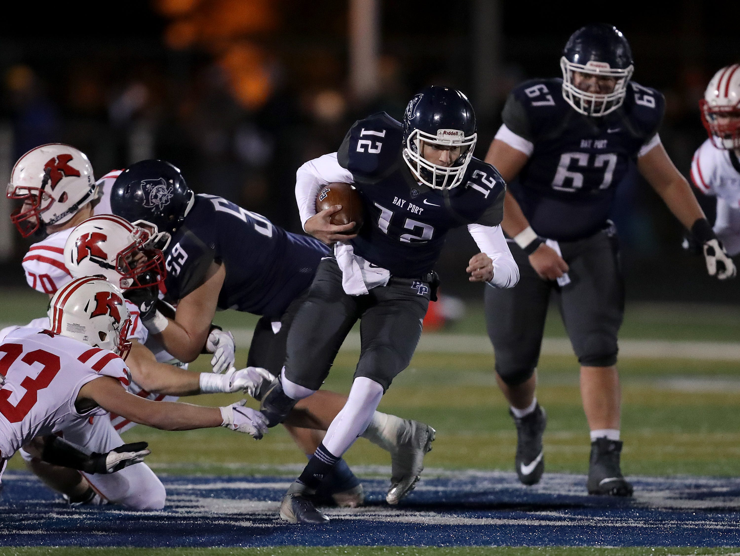 Bay Port High School's #12 Andrew Thomas runs against  Kimberly High School during their WIAA Division 1 state quarterfinal football game on Friday, November 2, 2018, in Suamico, Wis.  Kimberly defeated Bay Port 38 to 20. Wm. Glasheen/USA TODAY NETWORK-Wisconsin.