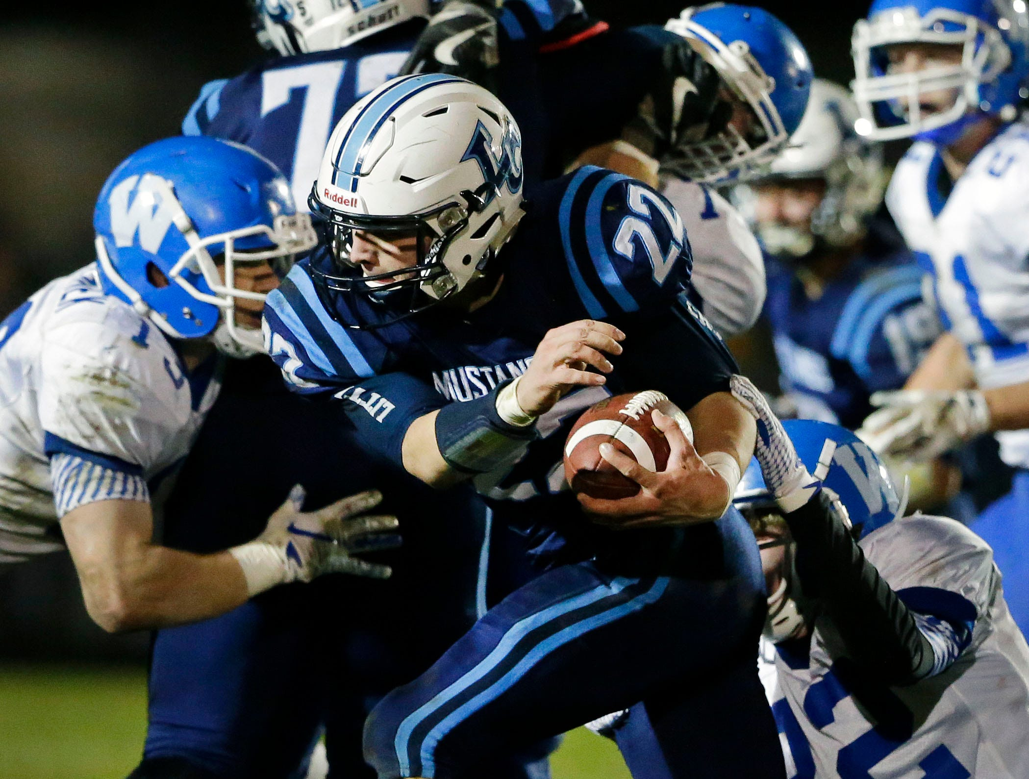 Bryce Schumacher of Little Chute carries the ball against Wrightstown in a WIAA Division 4 Level 3 playoff game Friday, November 2, 2018, at Fitzpatrick Field in Little Chute, Wis.Ron Page/USA TODAY NETWORK-Wisconsin