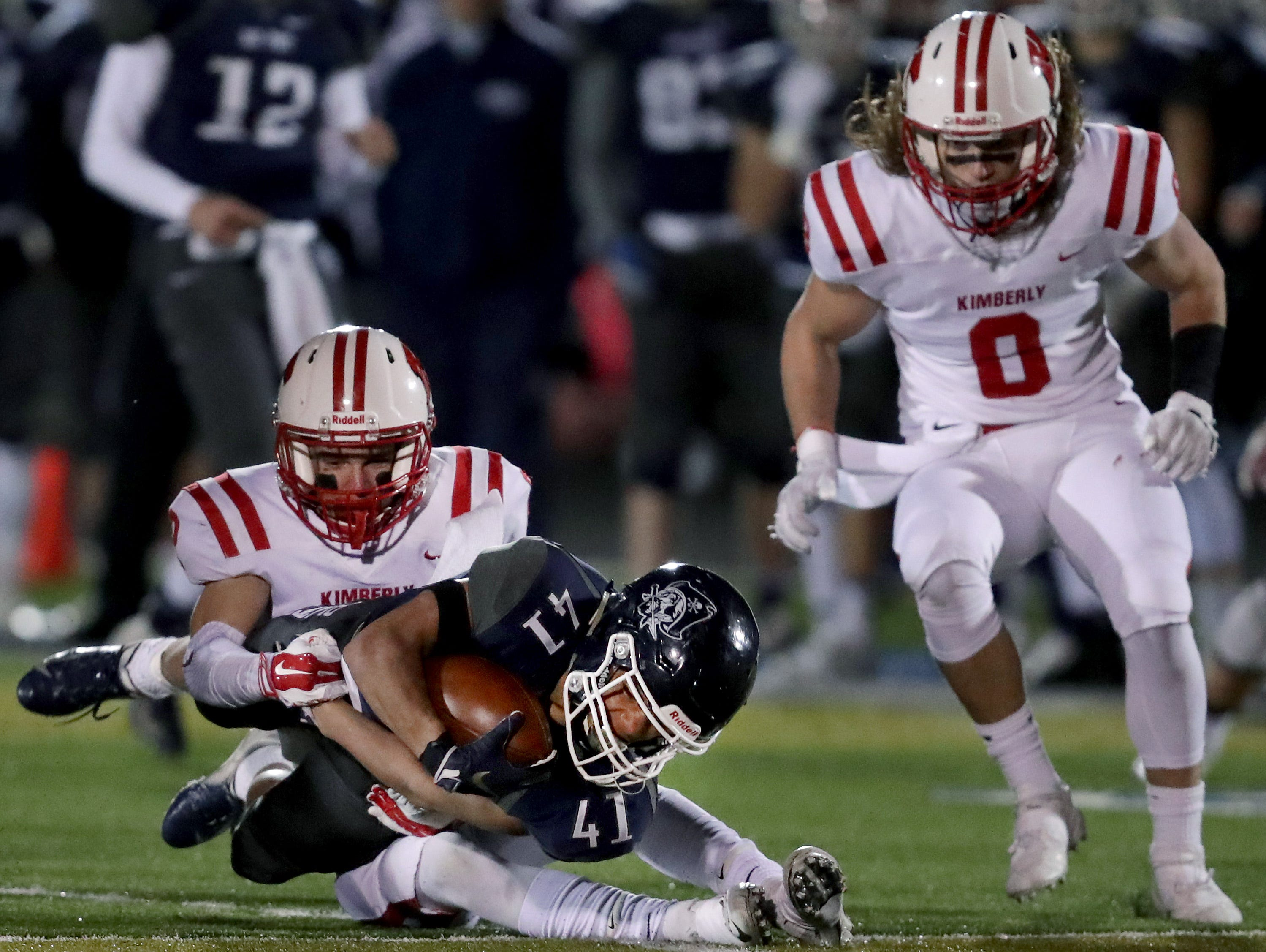 Bay Port High School's #41 Isaiah Gash against Kimberly High School's #2 Drew Lechnir and #8 Danny Kaltenbaugh during their WIAA Division 1 state quarterfinal football game on Friday, November 2, 2018, in Suamico, Wis.  Kimberly defeated Bay Port 38 to 20. Wm. Glasheen/USA TODAY NETWORK-Wisconsin.