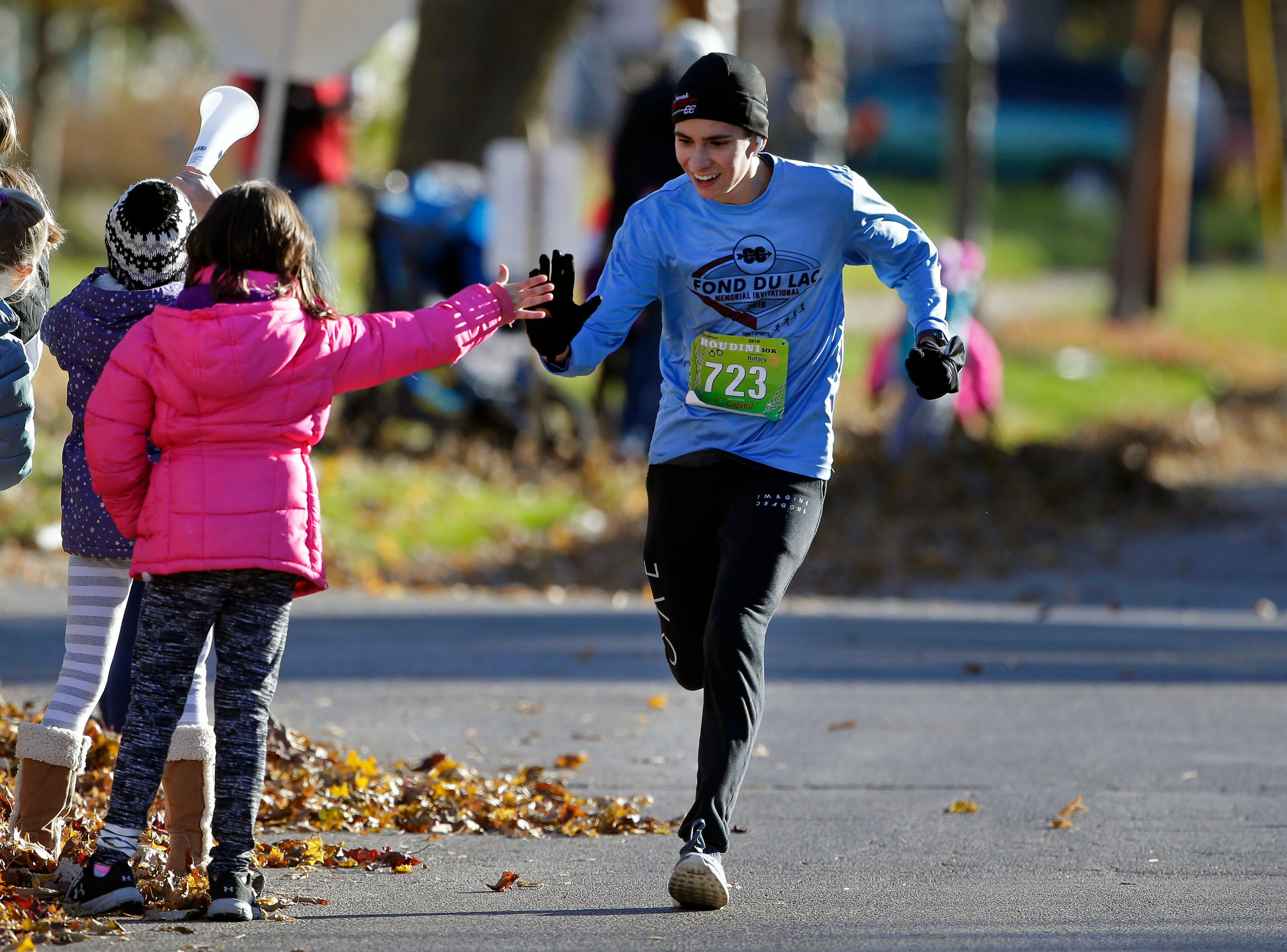 Josh Ryan gets congratulations near the finish as the 4th annual Appleton Houdini 10K takes place Saturday, November 3, 2018, in Appleton, Wis.