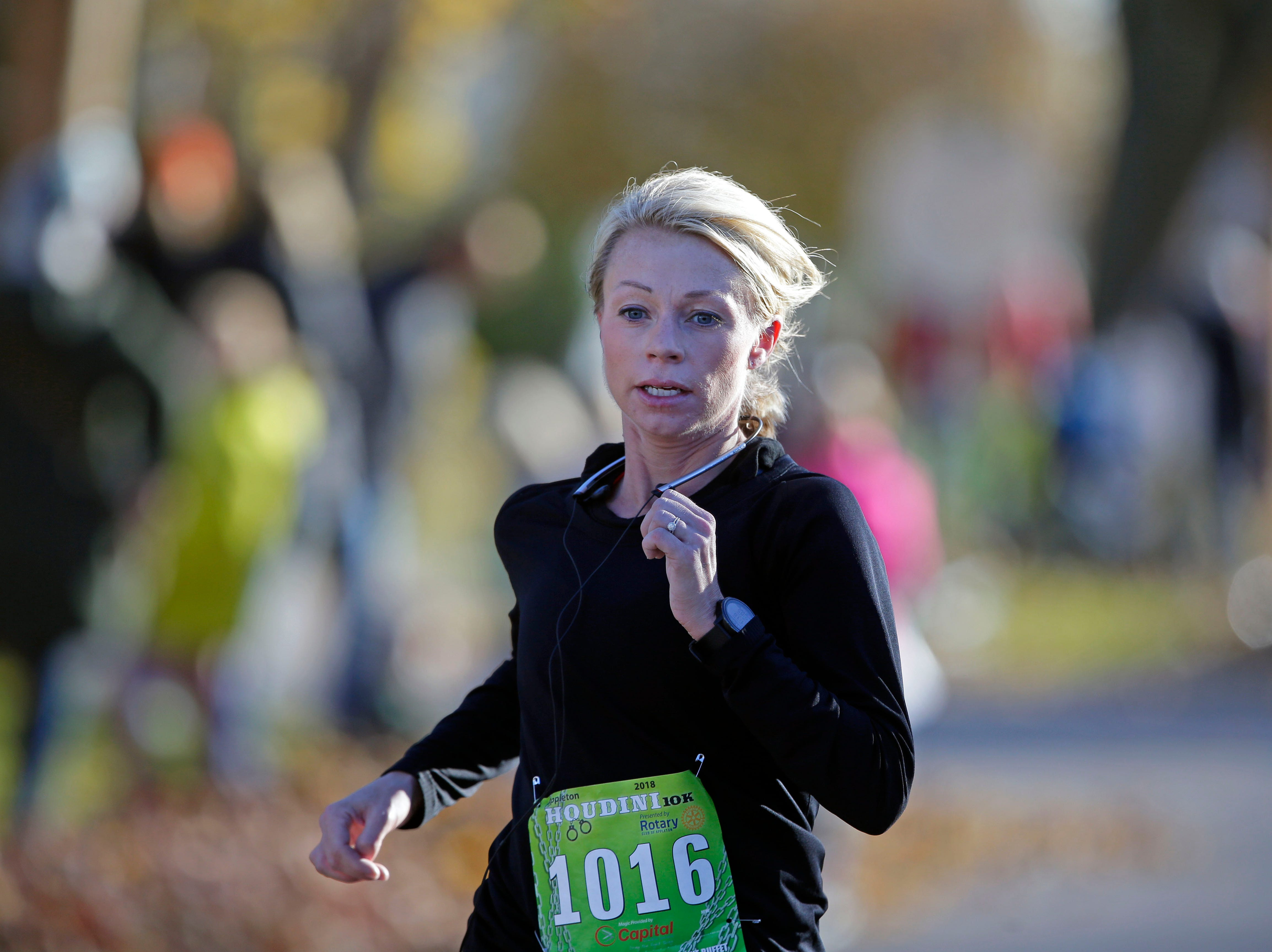 Kristin Oehlke finishes second in the women's division as the 4th annual Appleton Houdini 10K takes place Saturday, November 3, 2018, in Appleton, Wis.