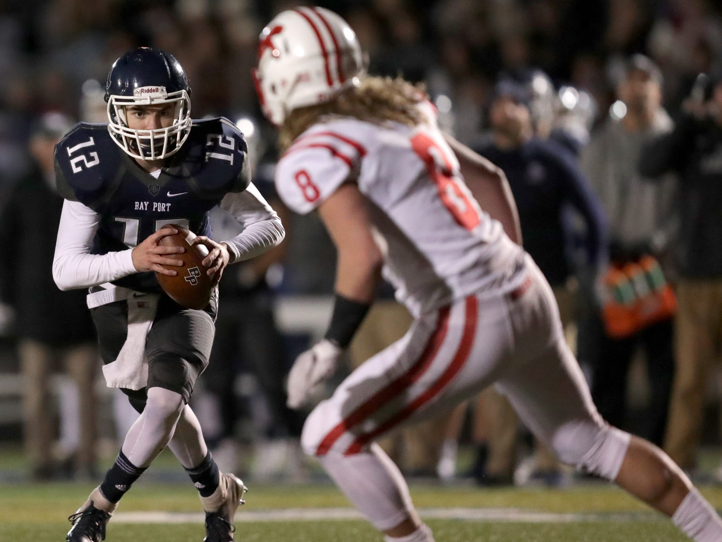 Bay Port High School's #12 Andrew Thomas against Kimberly High School during their WIAA Division 1 state quarterfinal football game on Friday, November 2, 2018, in Suamico, Wis.  Kimberly defeated Bay Port 38 to 20. Wm. Glasheen/USA TODAY NETWORK-Wisconsin.