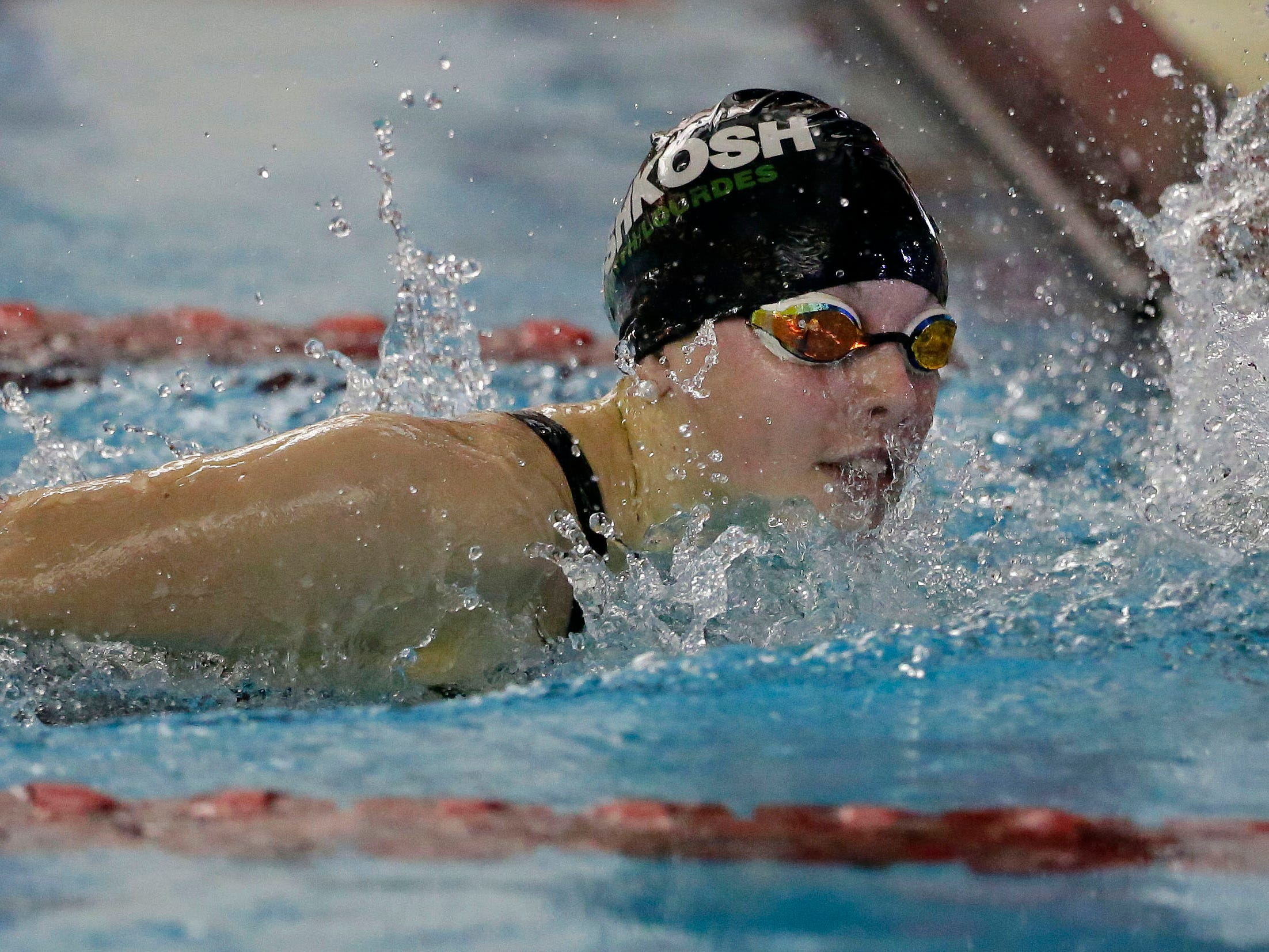 Ali Pecore of Oshkosh North/Lourdes looks at her time at the finish of the 500 Yard Freestyle as the WIAA Division 1 swimming sectional meet takes place Saturday, November 3, 2018, at Neenah High School in Neenah, Wis. Winners advanced to state.Ron Page/USA TODAY NETWORK-Wisconsin