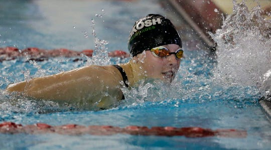 Ali Pecore of Oshkosh North/Lourdes looks at her time at the finish of the 500 freestyle at the WIAA Division 1 swimming sectional meet at Neenah.