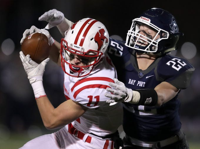 Kimberly High School's #11 Conner Wnek against Bay Port High School's #22 Jake Berg during their WIAA Division 1 state quarterfinal football game on Friday, November 2, 2018, in Suamico, Wis.  Kimberly defeated Bay Port 38 to 20. Wm. Glasheen/USA TO DAY NETWORK-Wisconsin.