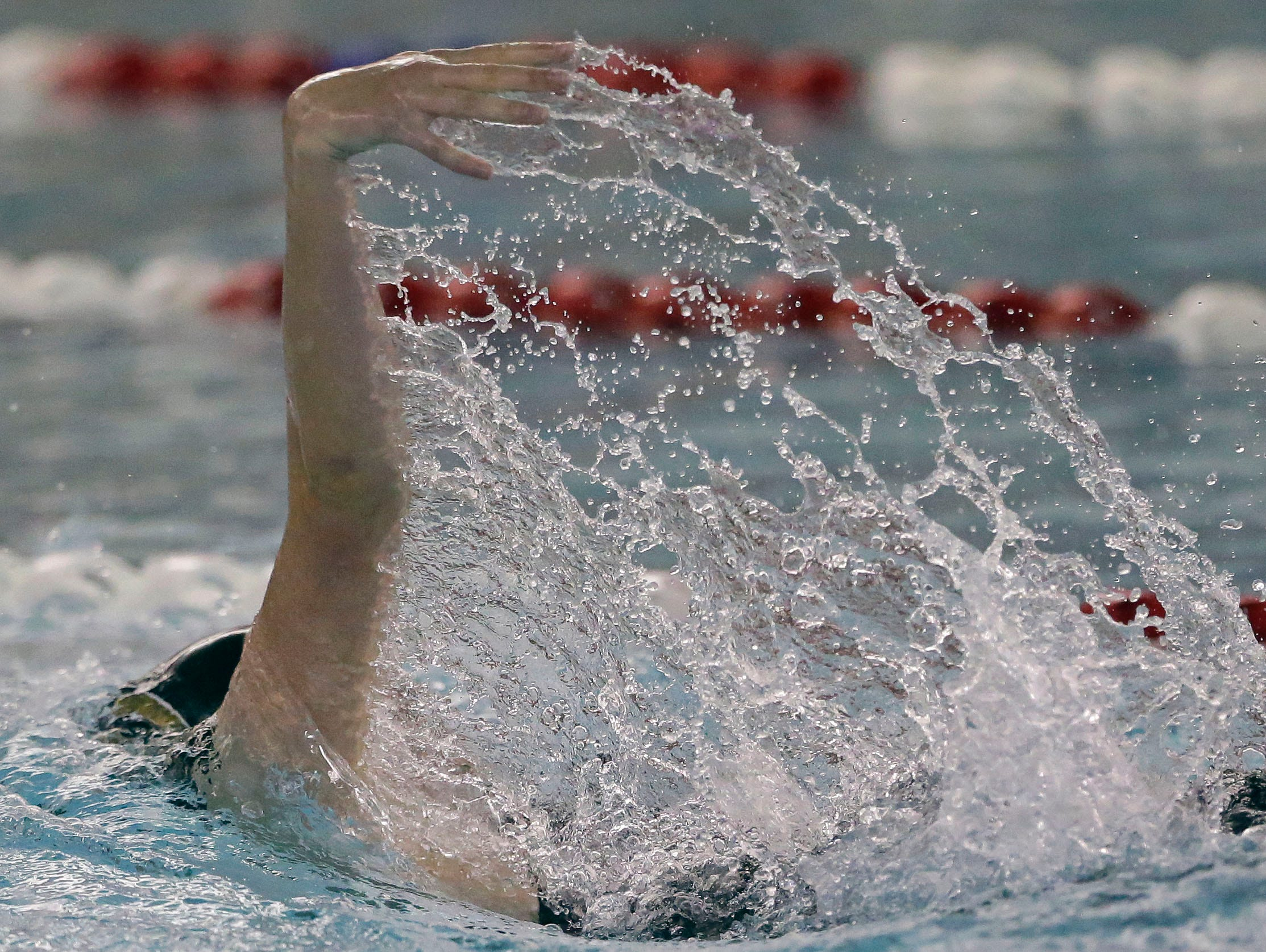 Water is frozen as Brigitta Neverman of Green Bay SW swims the 100 Yard Backstroke as the WIAA Division 1 swimming sectional meet takes place Saturday, November 3, 2018, at Neenah High School in Neenah, Wis. Winners advanced to state.Ron Page/USA TODAY NETWORK-Wisconsin