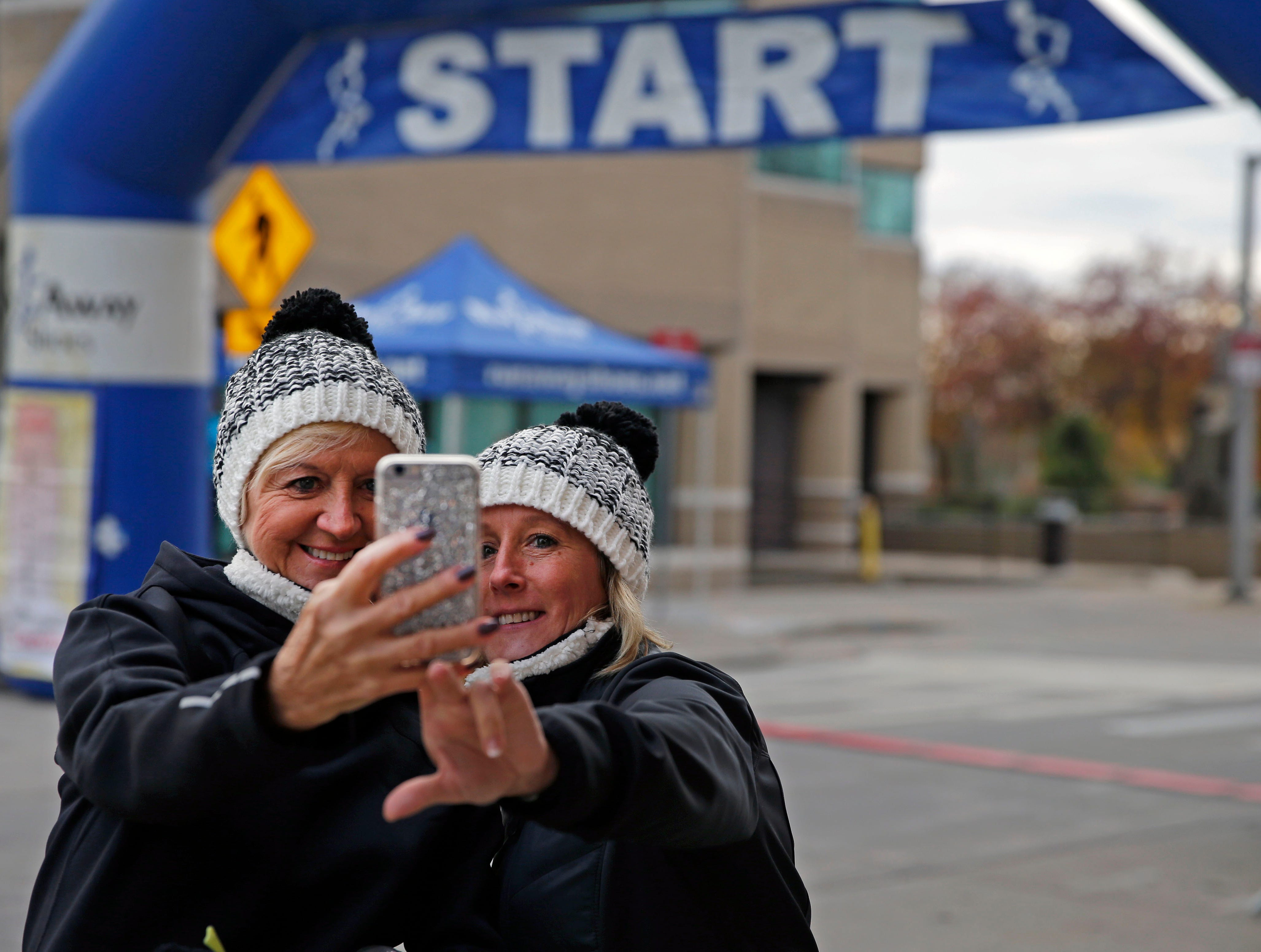 Felicia Hazen (left) and Lisa Mahan get a photo at the start before the 4th annual Appleton Houdini 10K takes place Saturday, November 3, 2018, in Appleton, Wis.