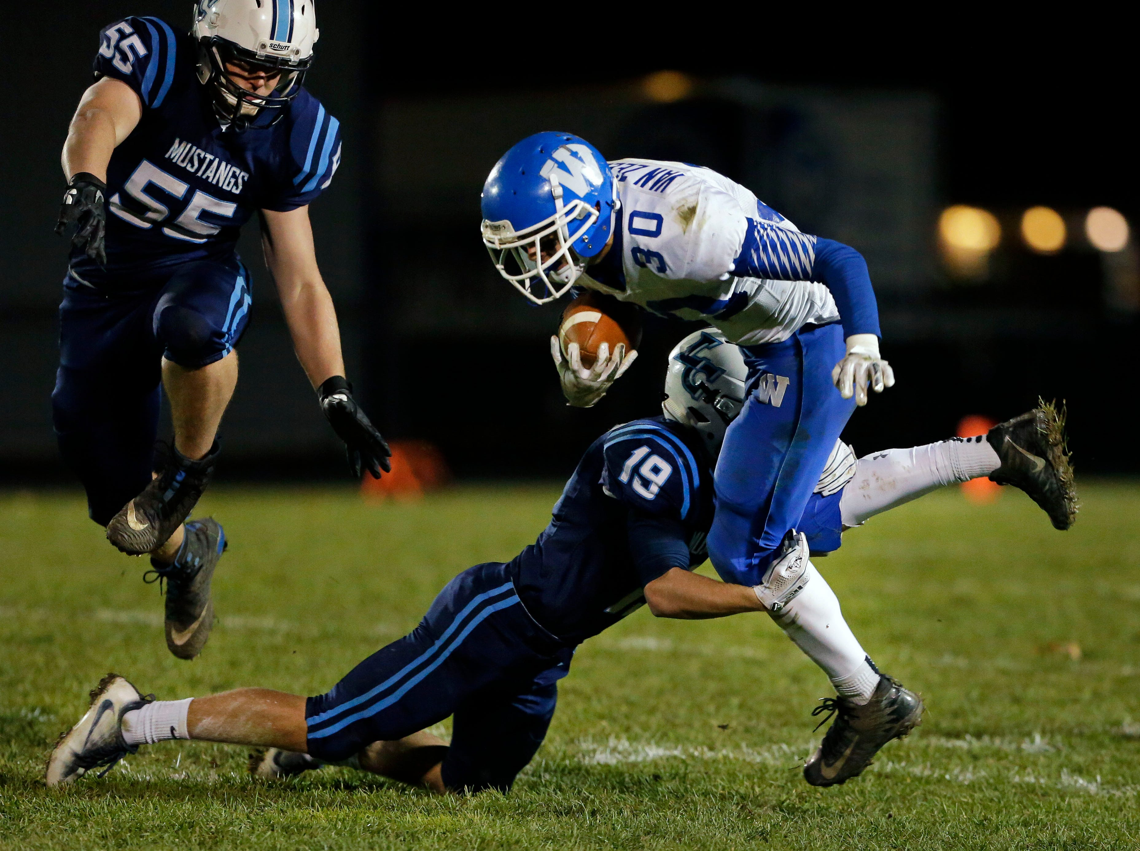 Jacob Lillge of Little Chute tackles Jeremy Van Zeeland of Wrightstown in a WIAA Division 4 Level 3 playoff game Friday, November 2, 2018, at Fitzpatrick Field in Little Chute, Wis.Ron Page/USA TODAY NETWORK-Wisconsin