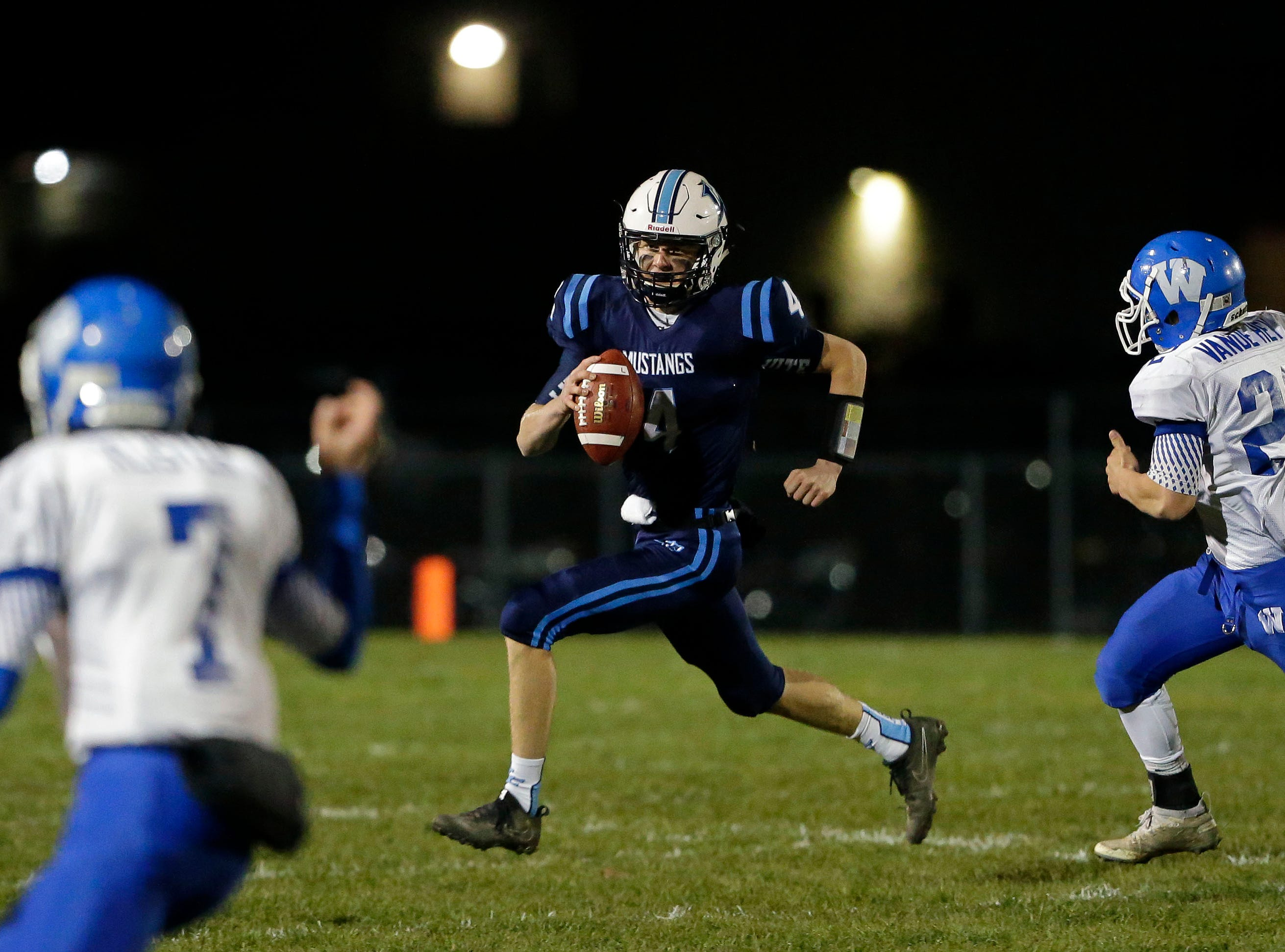 Noah Mueller of Little Chute is pursued by the defense of Wrightstown in a WIAA Division 4 Level 3 playoff game Friday, November 2, 2018, at Fitzpatrick Field in Little Chute, Wis.Ron Page/USA TODAY NETWORK-Wisconsin