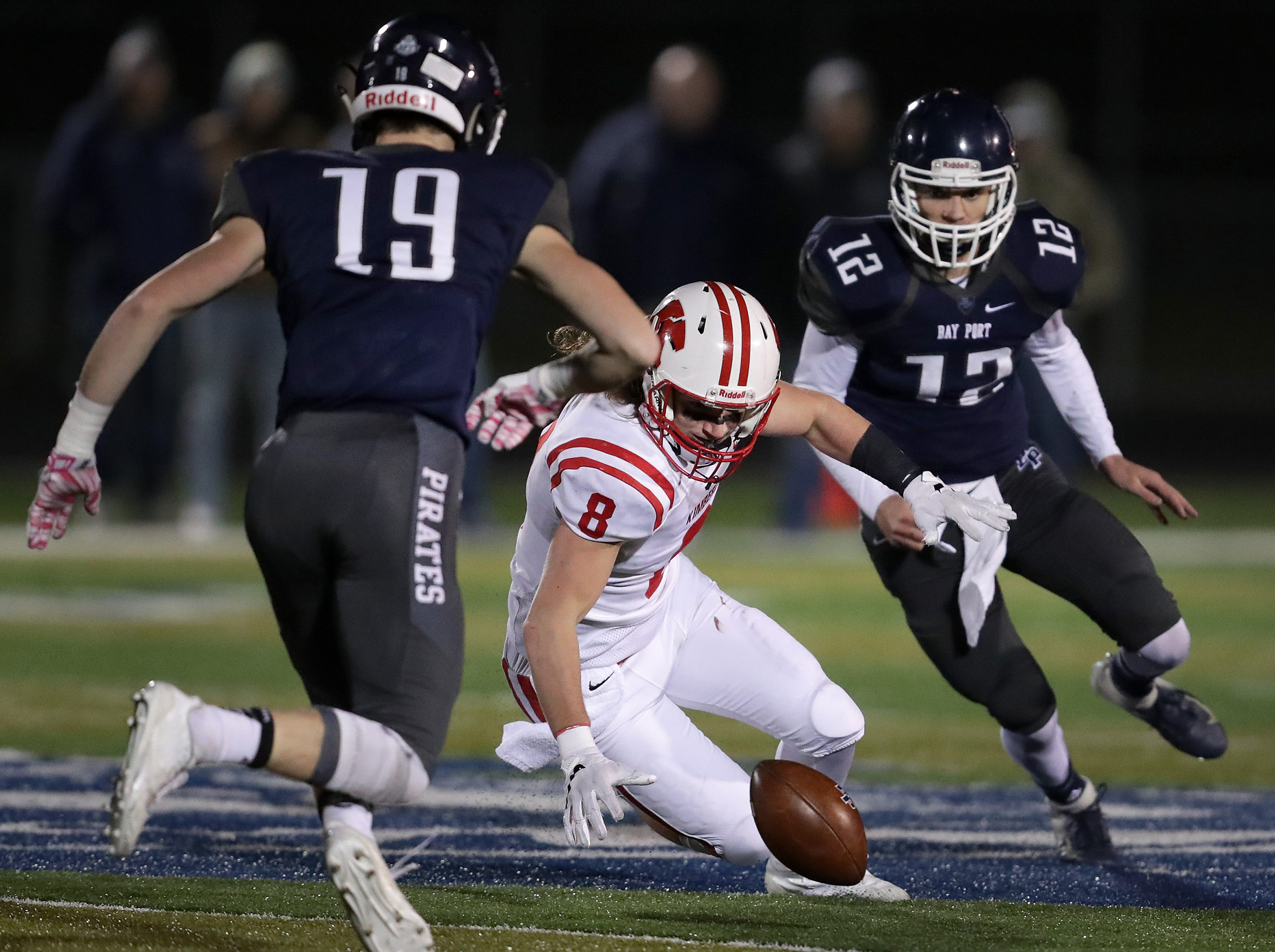 Kimberly High School's #8 Danny Kaltenbaugh recovers a second half fumble against Bay Port High School during their WIAA Division 1 state quarterfinal football game on Friday, November 2, 2018, in Suamico, Wis.  Kimberly defeated Bay Port 38 to 20. Wm. Glasheen/USA TODAY NETWORK-Wisconsin.