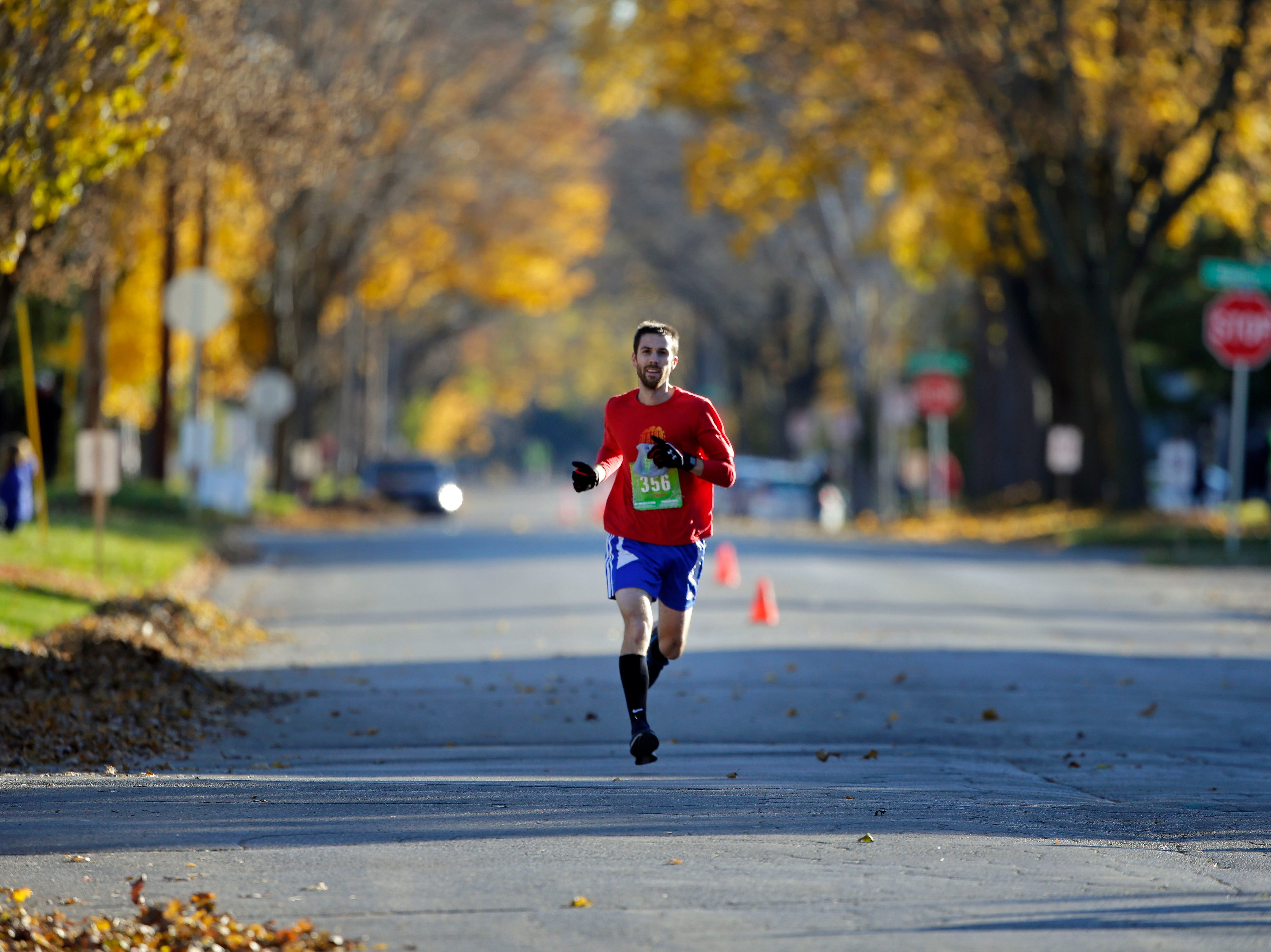 John Hollister nears the finish of the 4th annual Appleton Houdini 10K Saturday, November 3, 2018, in Appleton, Wis.