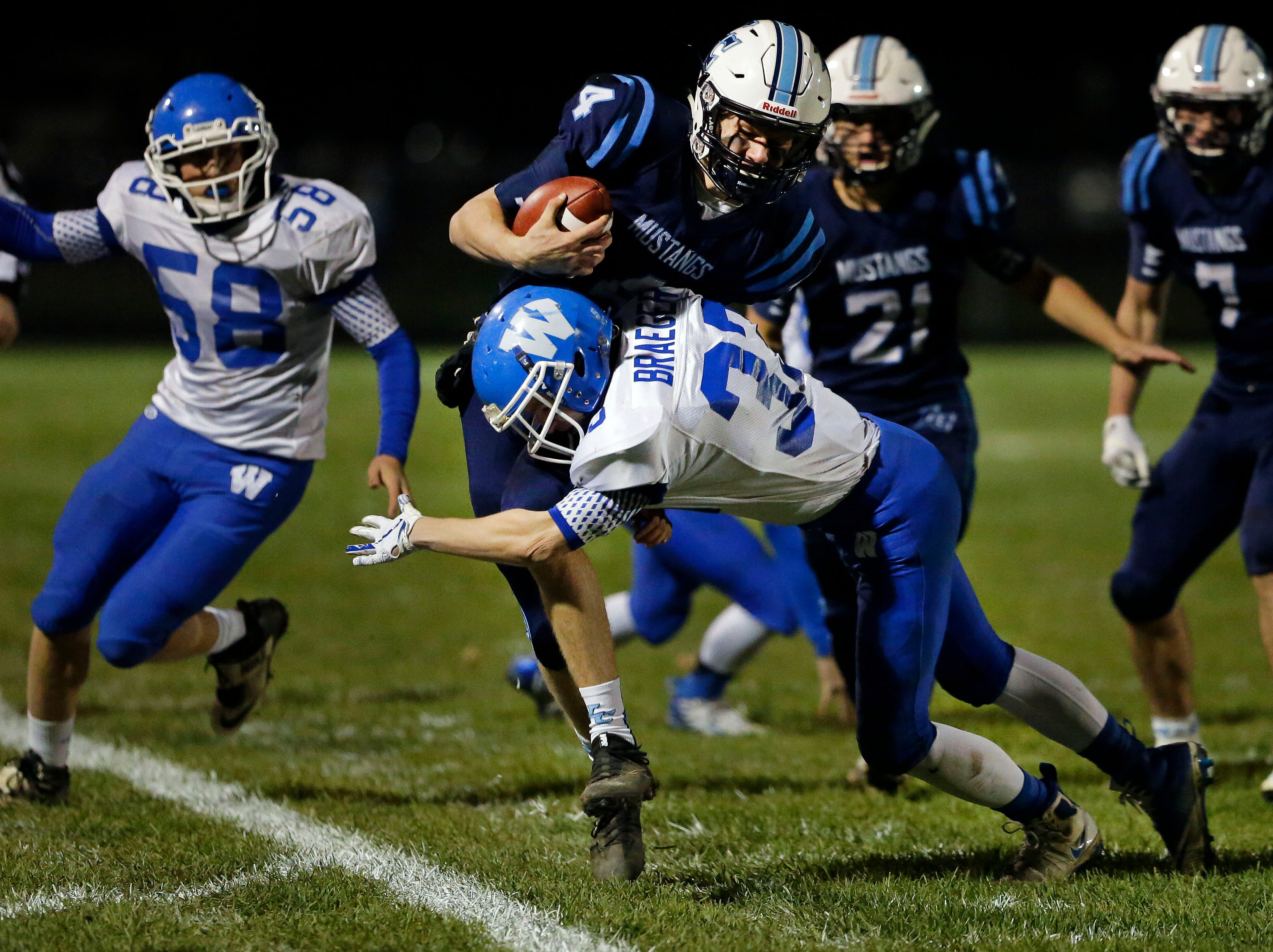 Noah Mueller of Little Chute is tackled by Will Braeger of Wrightstown in a WIAA Division 4 Level 3 playoff game Friday, November 2, 2018, at Fitzpatrick Field in Little Chute, Wis.Ron Page/USA TODAY NETWORK-Wisconsin
