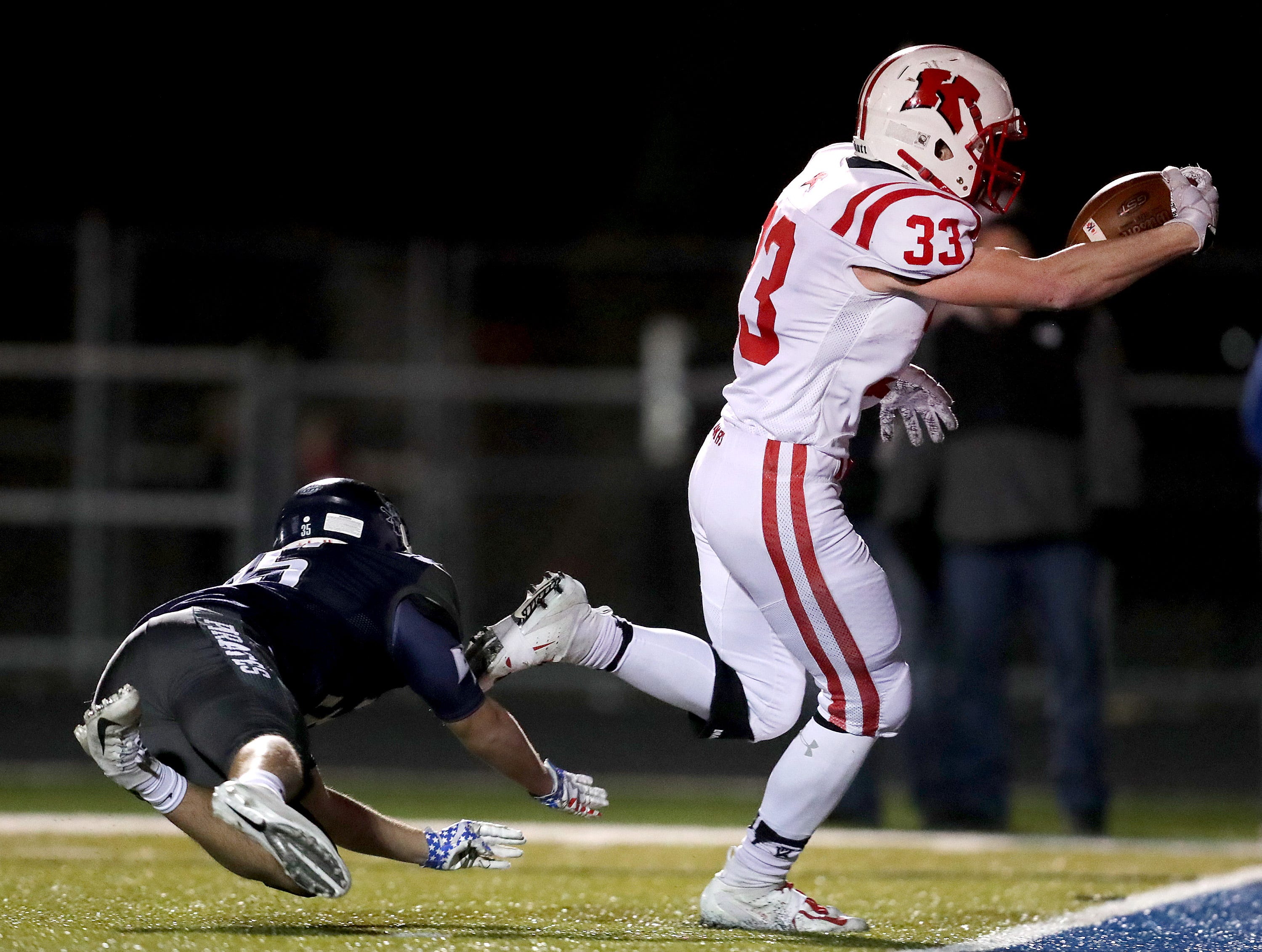 Kimberly High School's #33 Caleb Frazer crosses the goal line in the fourth quarter against Bay Port High School during their WIAA Division 1 state quarterfinal football game on Friday, November 2, 2018, in Suamico, Wis.  Kimberly defeated Bay Port 38 to 20. Wm. Glasheen/USA TODAY NETWORK-Wisconsin.