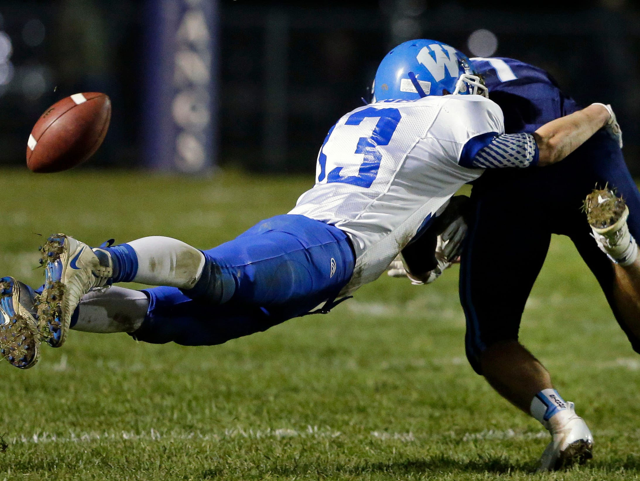 A pass to Adam Hietpas of Little Chute is incomplete as he is tackled by Will Braeger of Wrightstown in a WIAA Division 4 Level 3 playoff game Friday, November 2, 2018, at Fitzpatrick Field in Little Chute, Wis.Ron Page/USA TODAY NETWORK-Wisconsin
